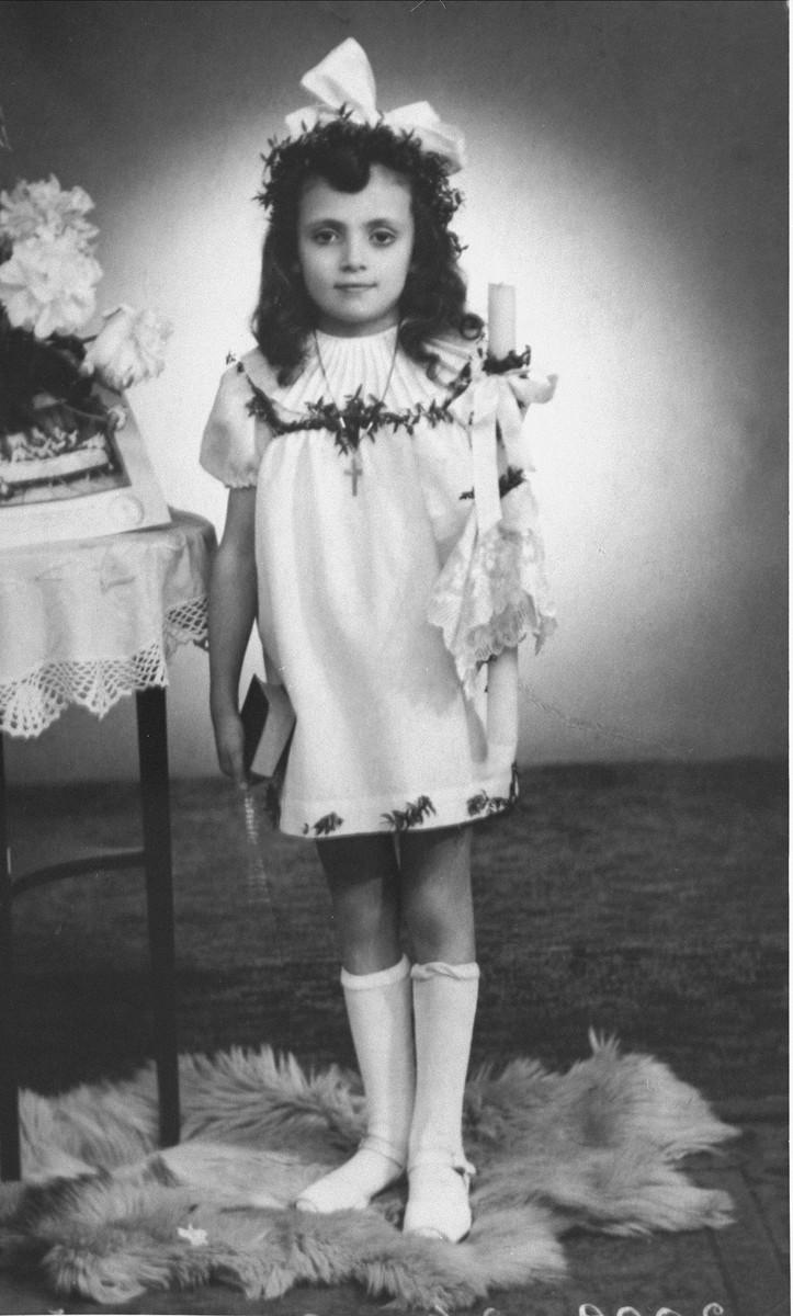 First Communion portrait of Janina Nebe, a Jewish child, who was hidden for three years by Leokadia Navrodska.