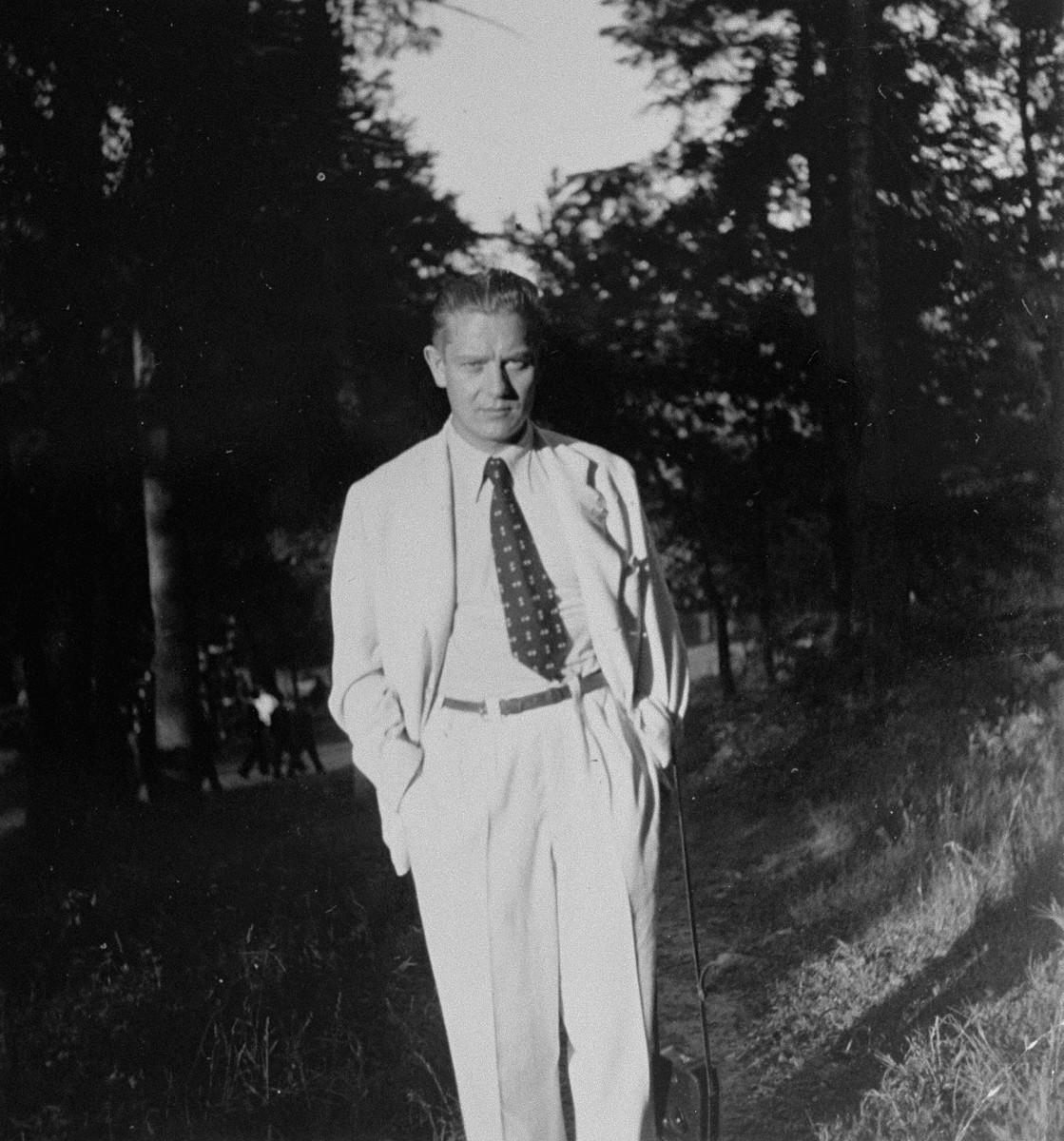 Portrait of Dr. Joseph Jaksy in a wooded area.