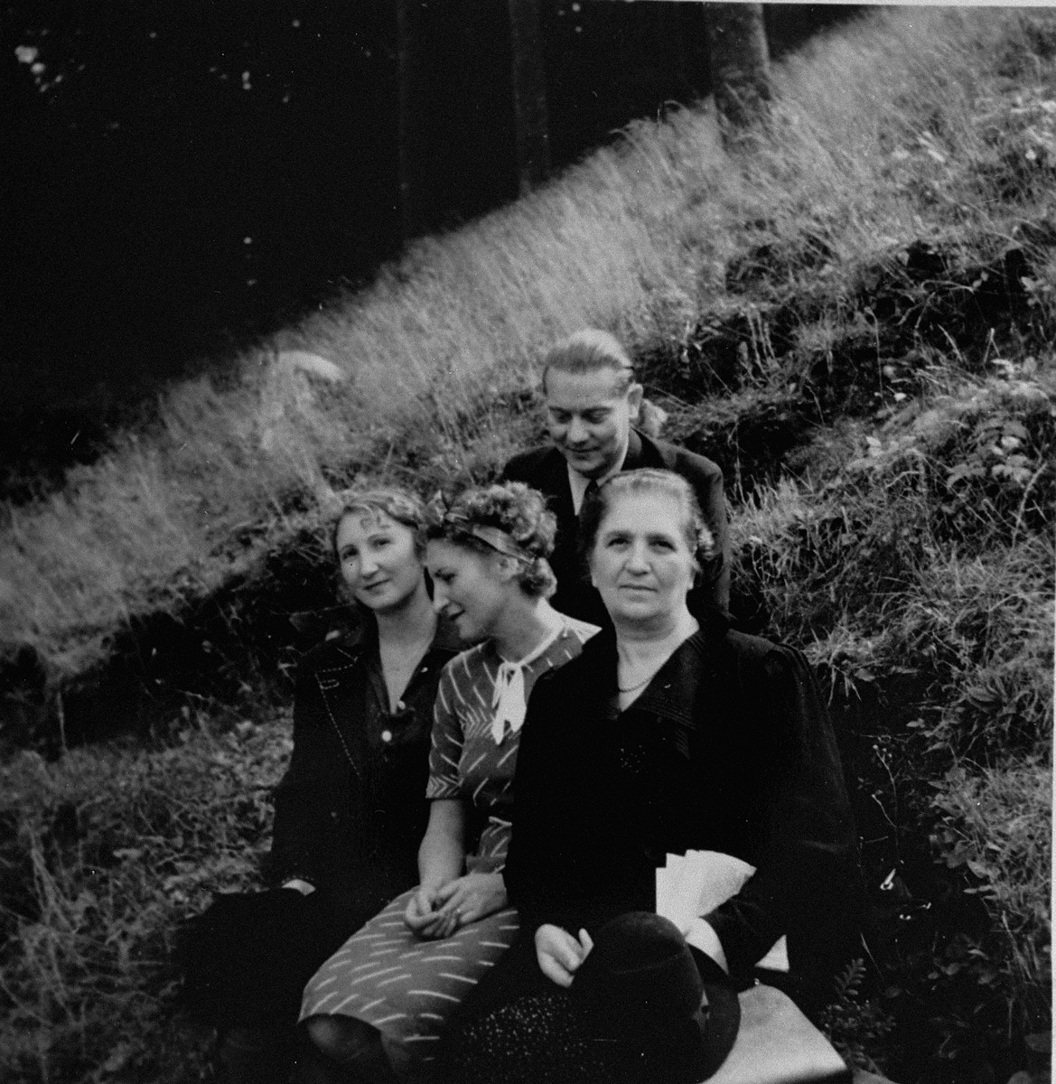 Dr. Joseph Jaksy poses on a hillside in Bratislava with members of the Suran family, whom he rescued during WWII.   Pictured with Dr. Jaksy from left to right are Valeria, Lydia and Mrs. Suran.  The Surans were among the 25 Jews rescued by Dr. Joseph Jaksy during WWII.  Jaksy engineered the fictitious purchase of the Suran's home in Bratislava; he provided false papers that allowed the Suran children to escape to South America; he registered the elder Surans as his own Slovak domestics; and, after a Gestapo search of the house, he provided Mrs. Suran with false papers and drove her to safety.