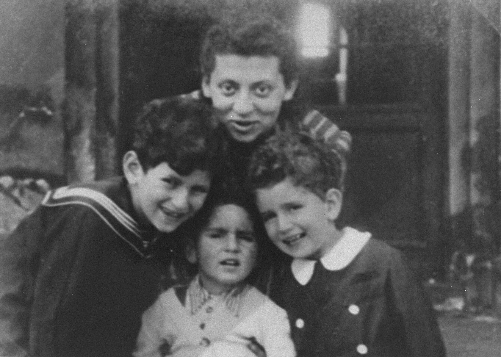 The three Gutgeld children pose with their aunt in the Warsaw Ghetto, prior to their being placed in hiding with Alex and Mela Roslan.   Pictured are Jacob, David and Shalom Gutgeld with their Aunt Janke.
