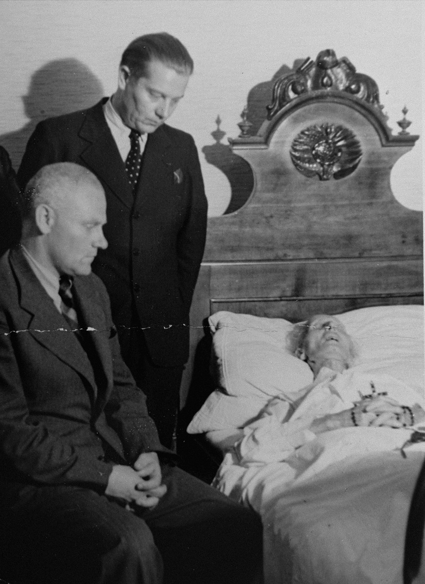 Dr. Joseph Jaksy (standing) tends to Andrej Hlinka on his deathbed.  He was honored posthumously by Yad Vashem as one of the Righteous Among the Nations.