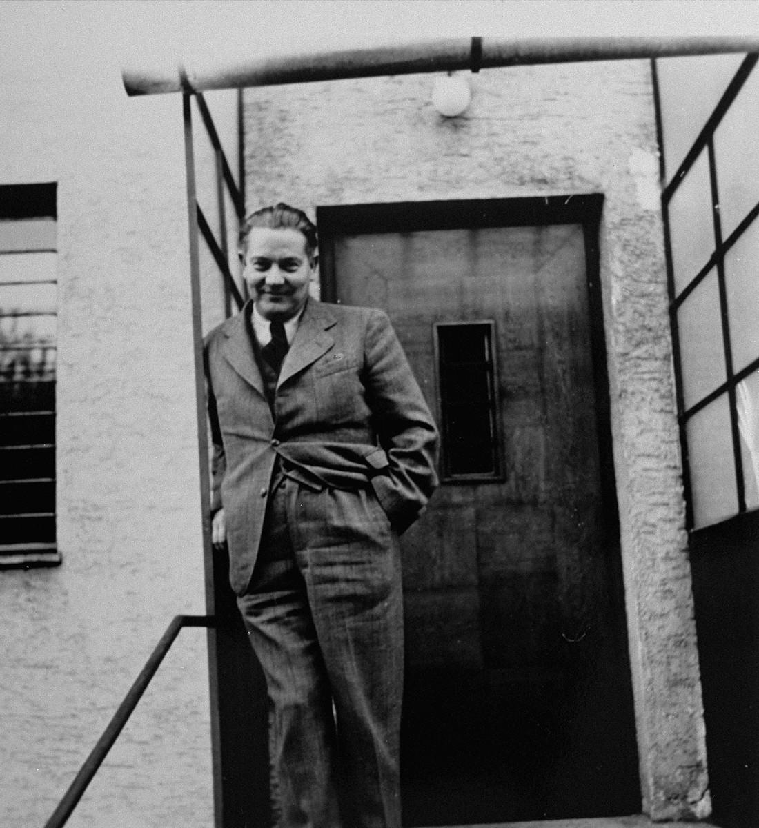 Portrait of Dr. Joseph Jaksy standing at the entrance to a building.