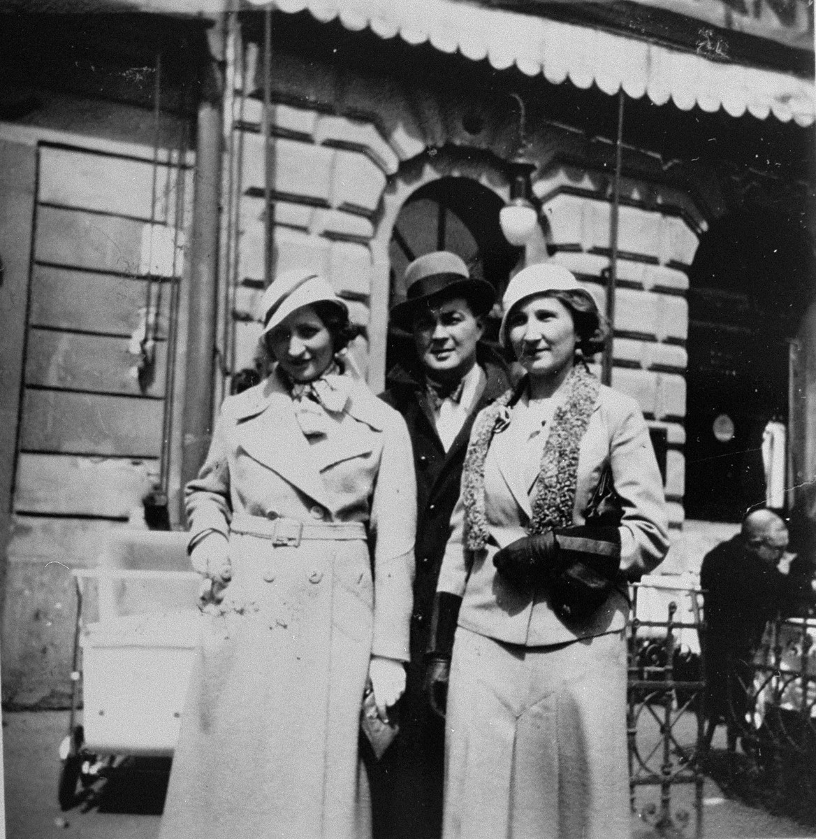 Dr. Joseph Jaksy poses on a street in Bratislava with Mrs. Suran and her daughter Valeria.    The Surans were among the 25 Jews rescued by Dr. Joseph Jaksy during WWII.  Jaksy engineered the fictitious purchase of the Suran's home in Bratislava; he provided false papers that allowed the Suran children to escape to South America; he registered the elder Surans as his own Slovak domestics; and, after a Gestapo search of the house, he provided Mrs. Suran with false papers and drove her to safety.