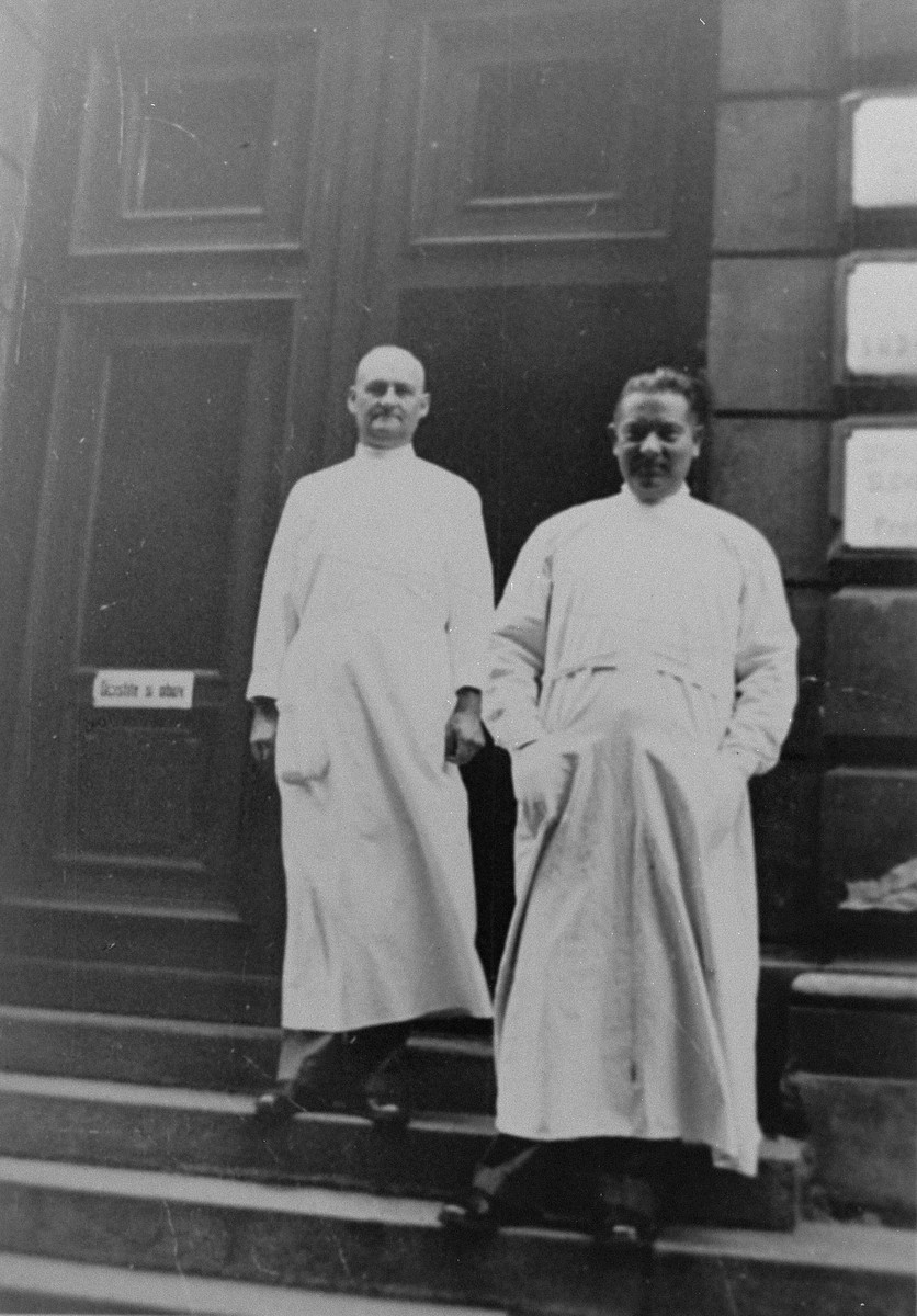 Dr. Joseph Jaksy (right) poses with a colleague at the entrance to his clinic in Bratislava.