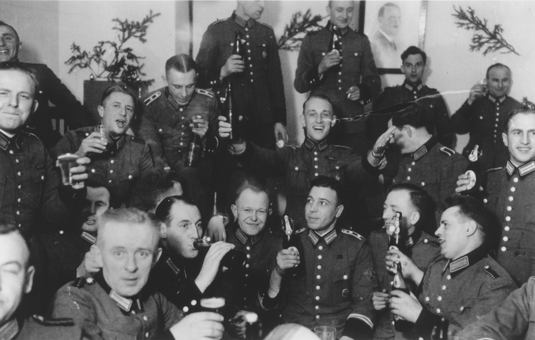 Members of Police Battalion 101 celebrate Christmas in their barracks.   One image from a photograph album belonging to a member of Police Battalion 101.