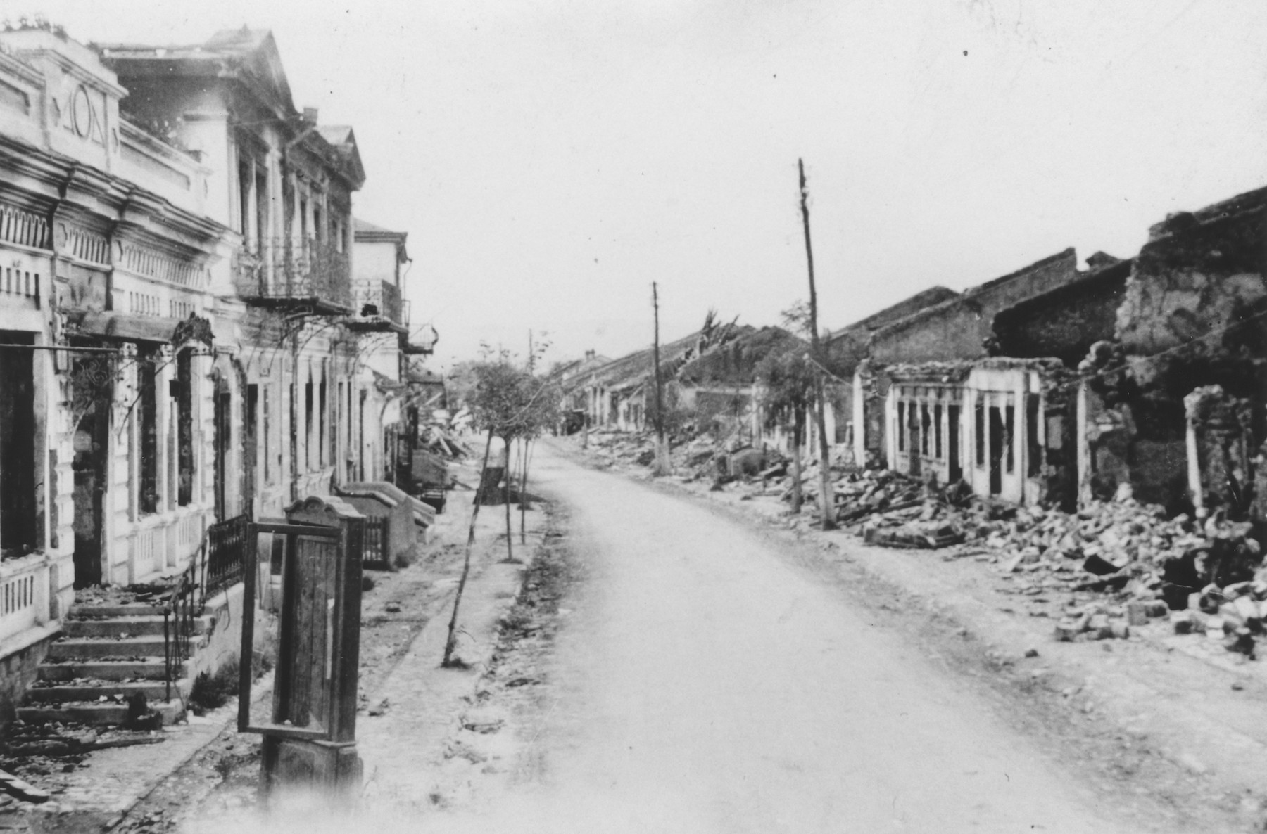 View of a bombed out street in German occupied eastern Europe.  The photograph was probably taken by a member of Police Battalion 101.   One image from a photograph album belonging to a member of Police Battalion 101.