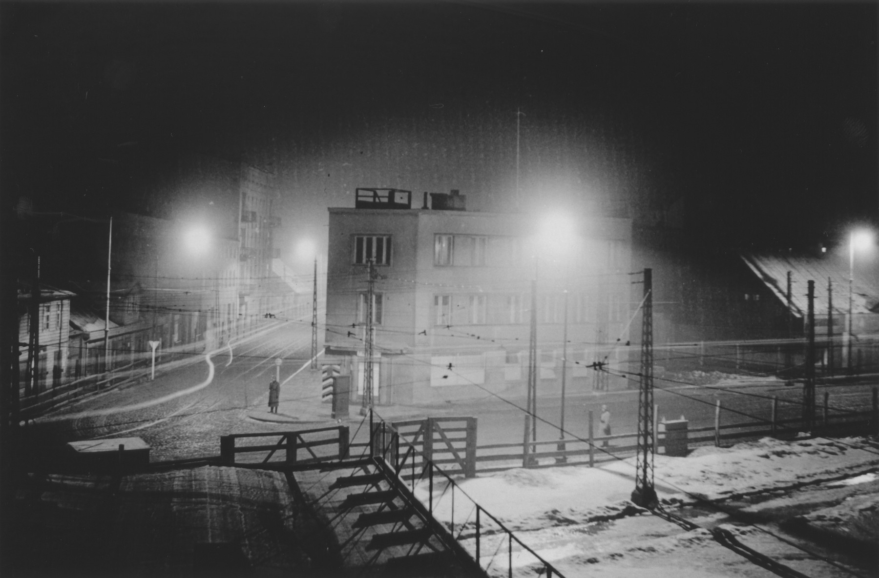 Night-time view of members of Police Battalion 101 guarding the perimeter of the Lodz ghetto.   One image from a photograph album belonging to a member of Police Battalion 101.