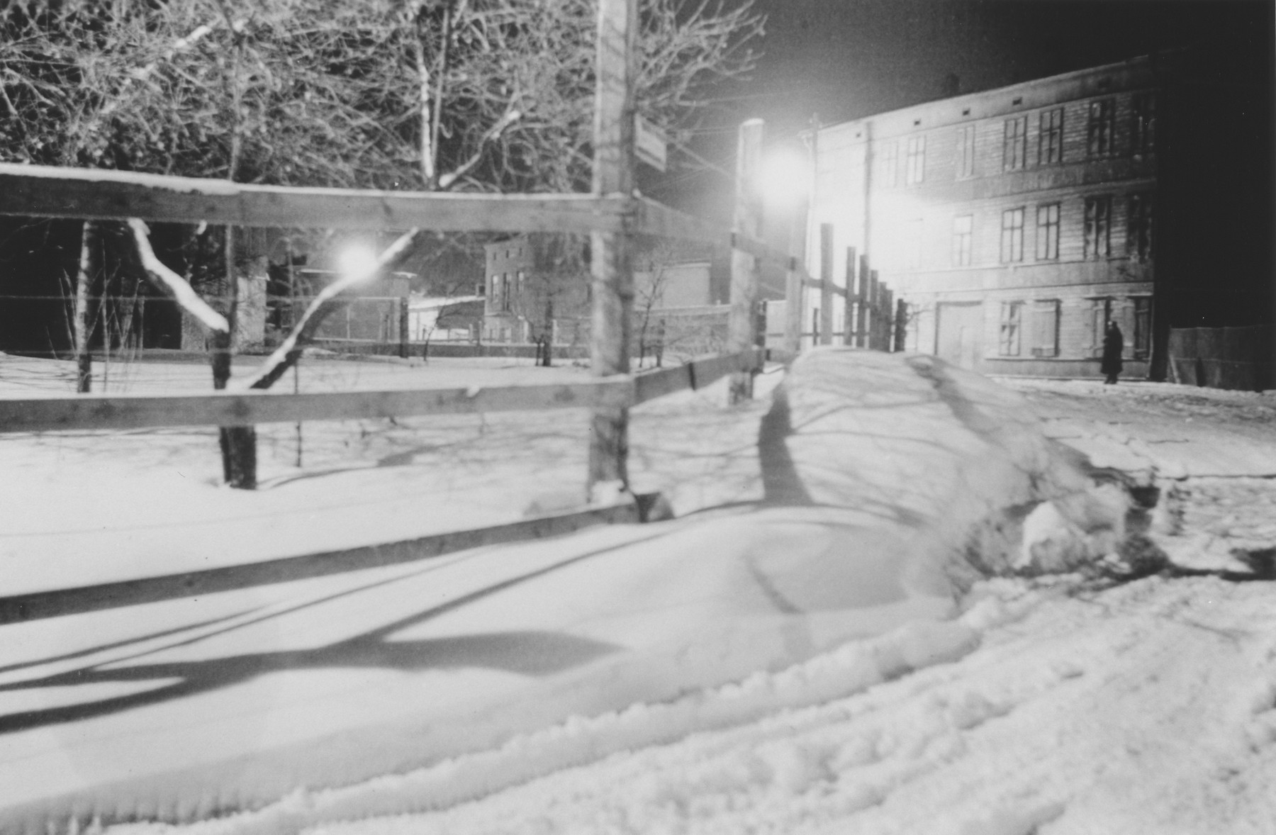 Night-time view of the fence surrounding the Lodz ghetto.  The photograph was probably taken by a member of Police Battalion 101.   One image from a photograph album belonging to a member of Police Battalion 101.