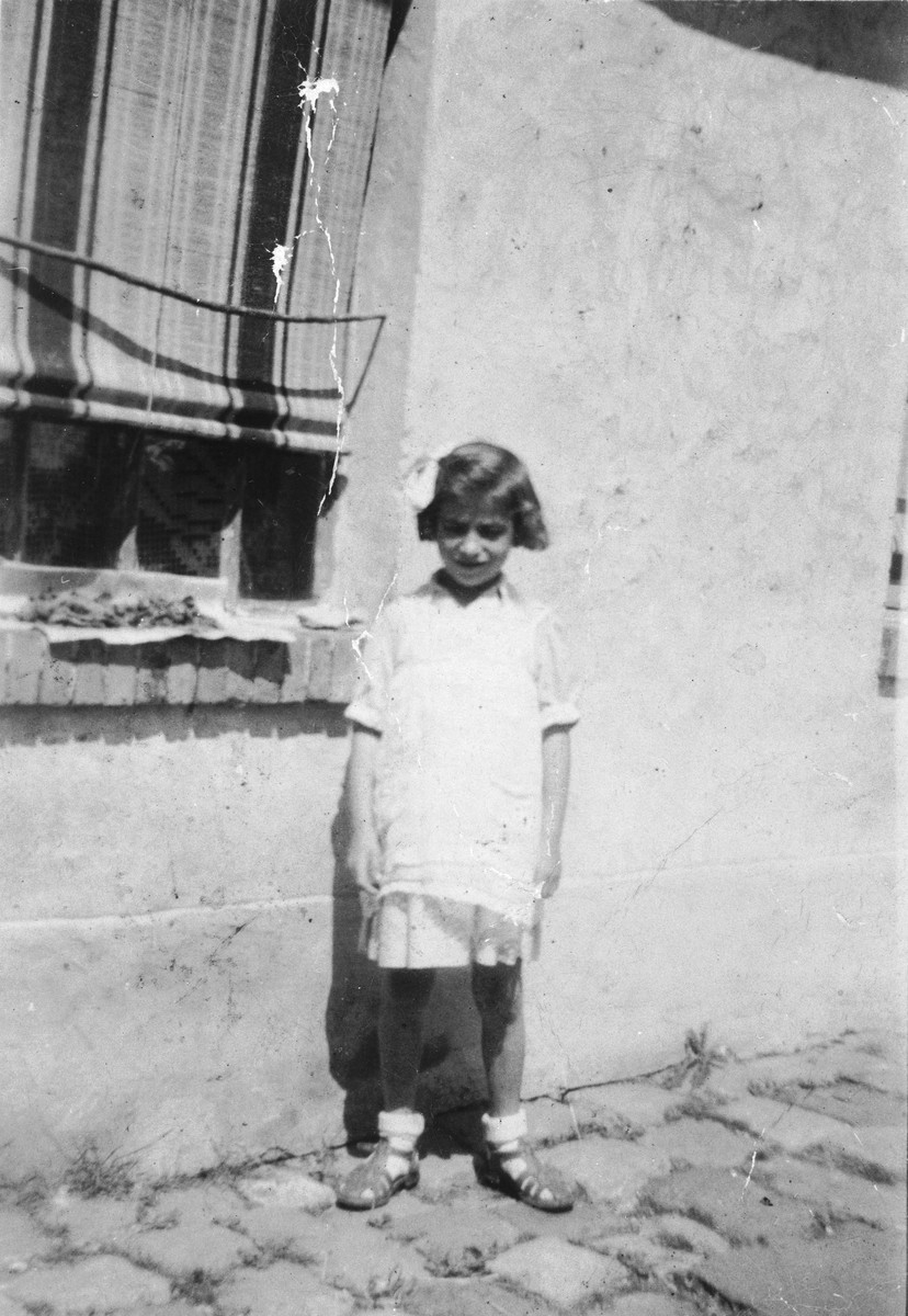 Blanche Krakowski stands outside the farm house where she is hiding.