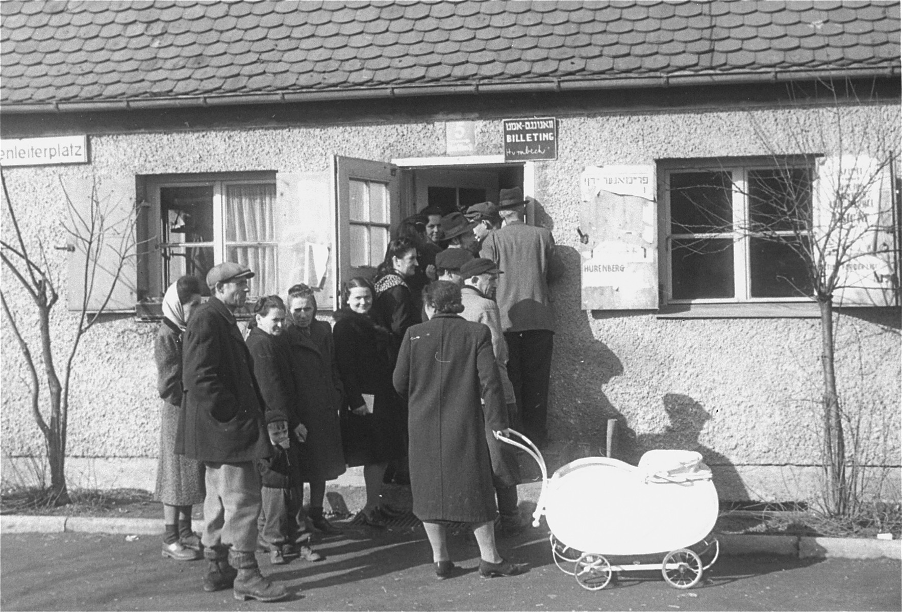 Jewish DPs stand in line at the entrance to the housing office at the Neu Freimann displaced persons camp.