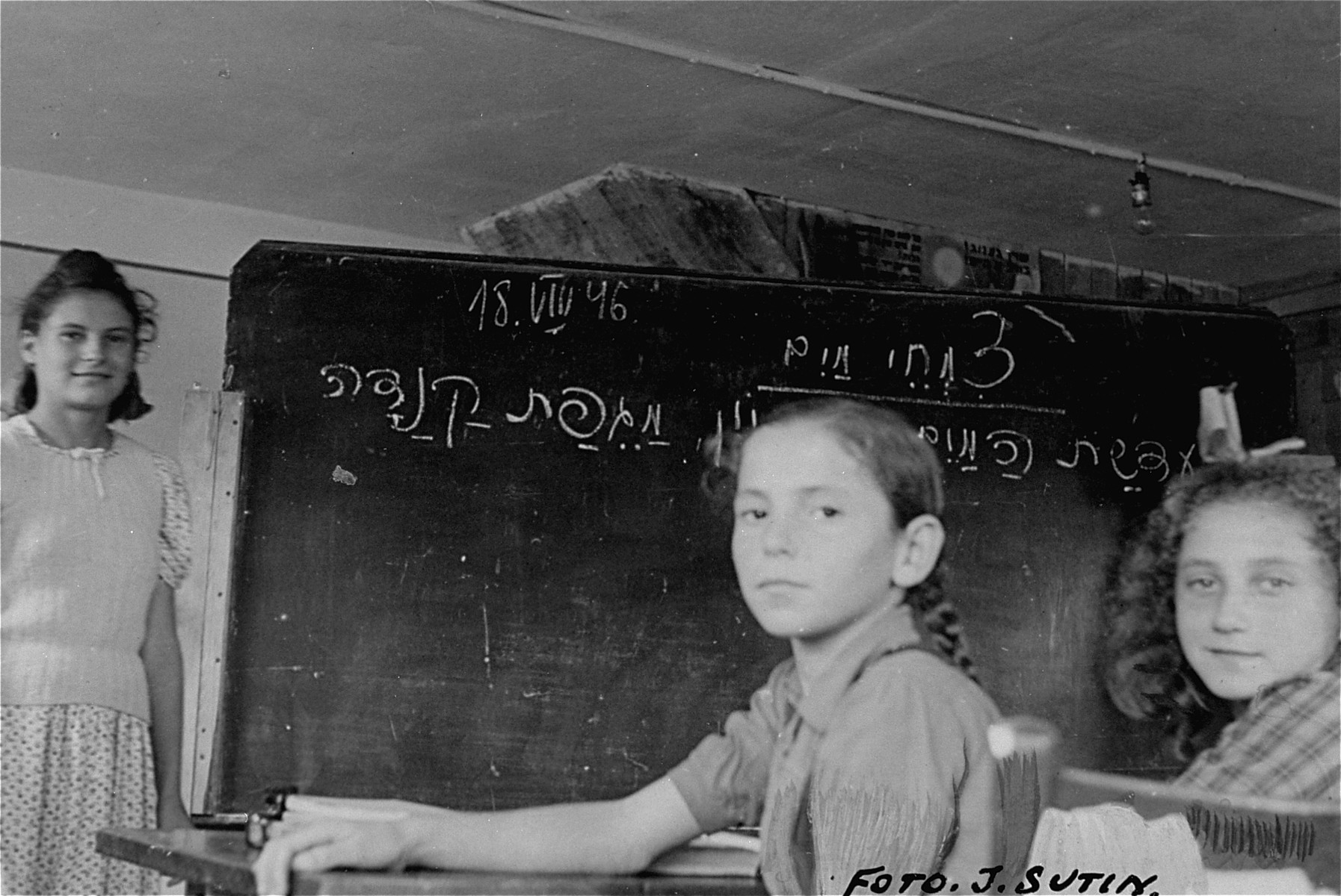 Jewish girls study Hebrew in a classroom at the Neu Freimann displaced persons camp.