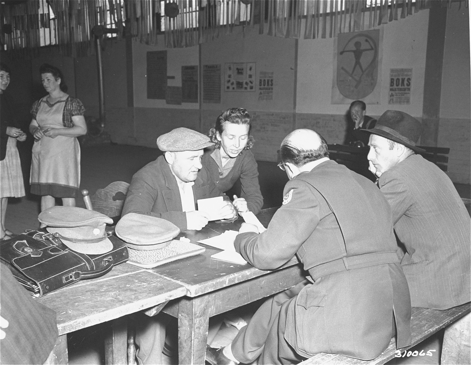 Two Jewish displaced persons at the DP camp in Wetzlar register to go to Palestine.  The Jewish Relief Organization has made arrangements for the immigration of Jewish DP's to Palestine.  At that time no men of military age were allowed to emigrate to Palestine.