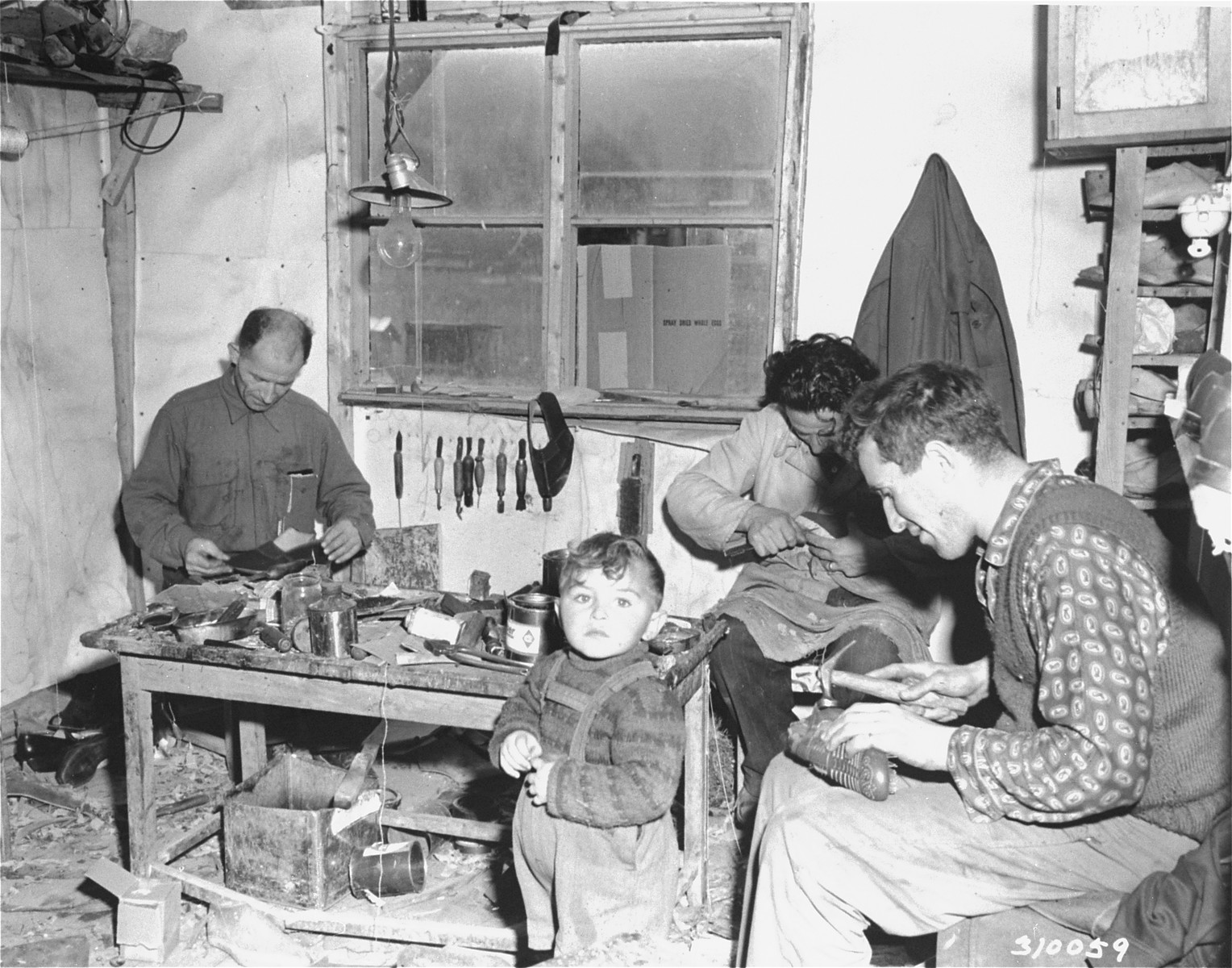 One of the shoe repair shops at the displaced persons camp in Wetzlar.