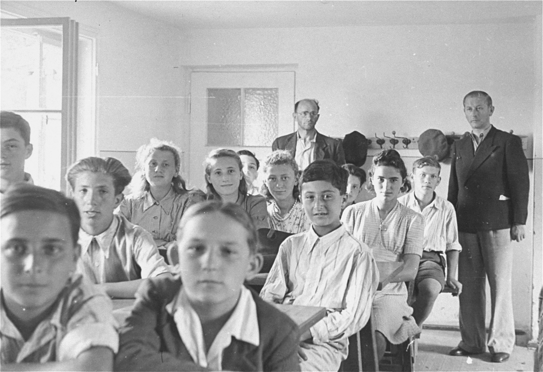 Students sit at their desks in a classroom at the Neu Freimann displaced persons camp.