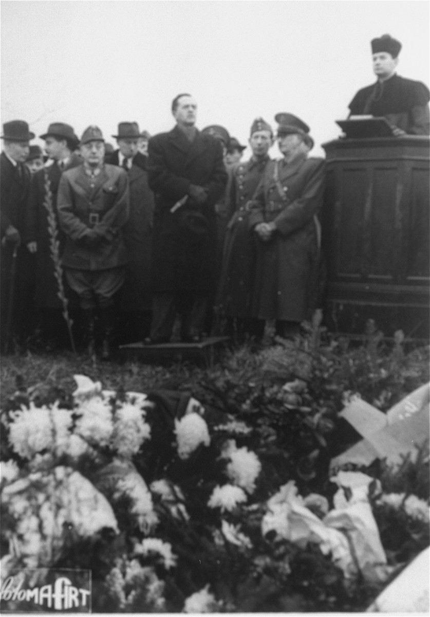 Rabbi Jozsef Katona (right) conducts a memorial service at the Jewish cemetery, 6 Kozma Street, on the occasion of the reinterment of 1,526 Jewish victims killed during the executions of labor battalions in Hidegseg, Ilona-Major and Fertorakos at the end of the war.     The Righteous Gentile and former minister of defense during the Horthy regime, General Vilmos Nagy speaks at the grave site.