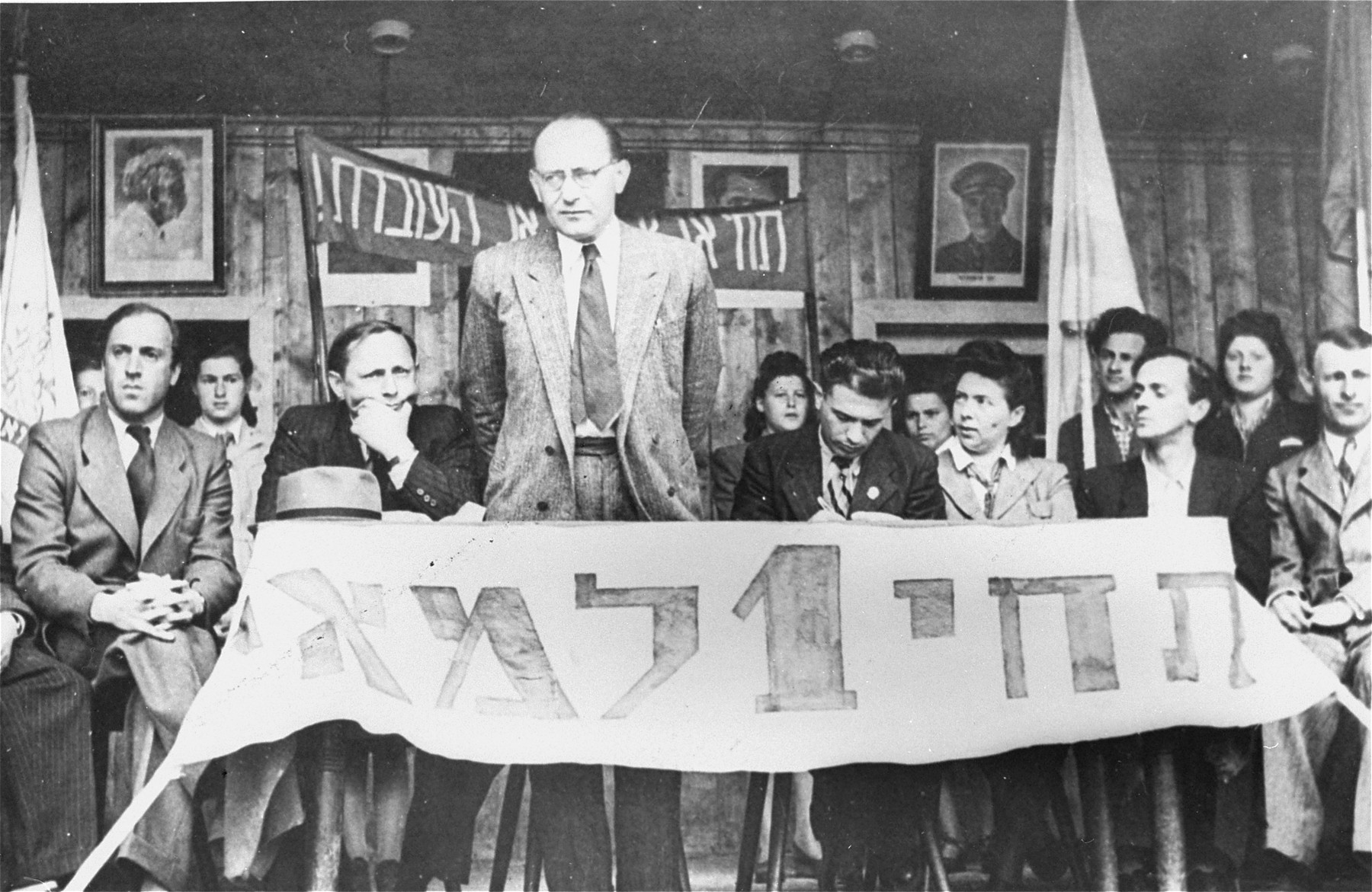 Chaim (Hoffman) Yahil, representative of the Jewish Agency in Germany, addresses an outdoor meeting of Jewish DPs at an official May Day celebration at the Neu Freimann displaced persons camp.