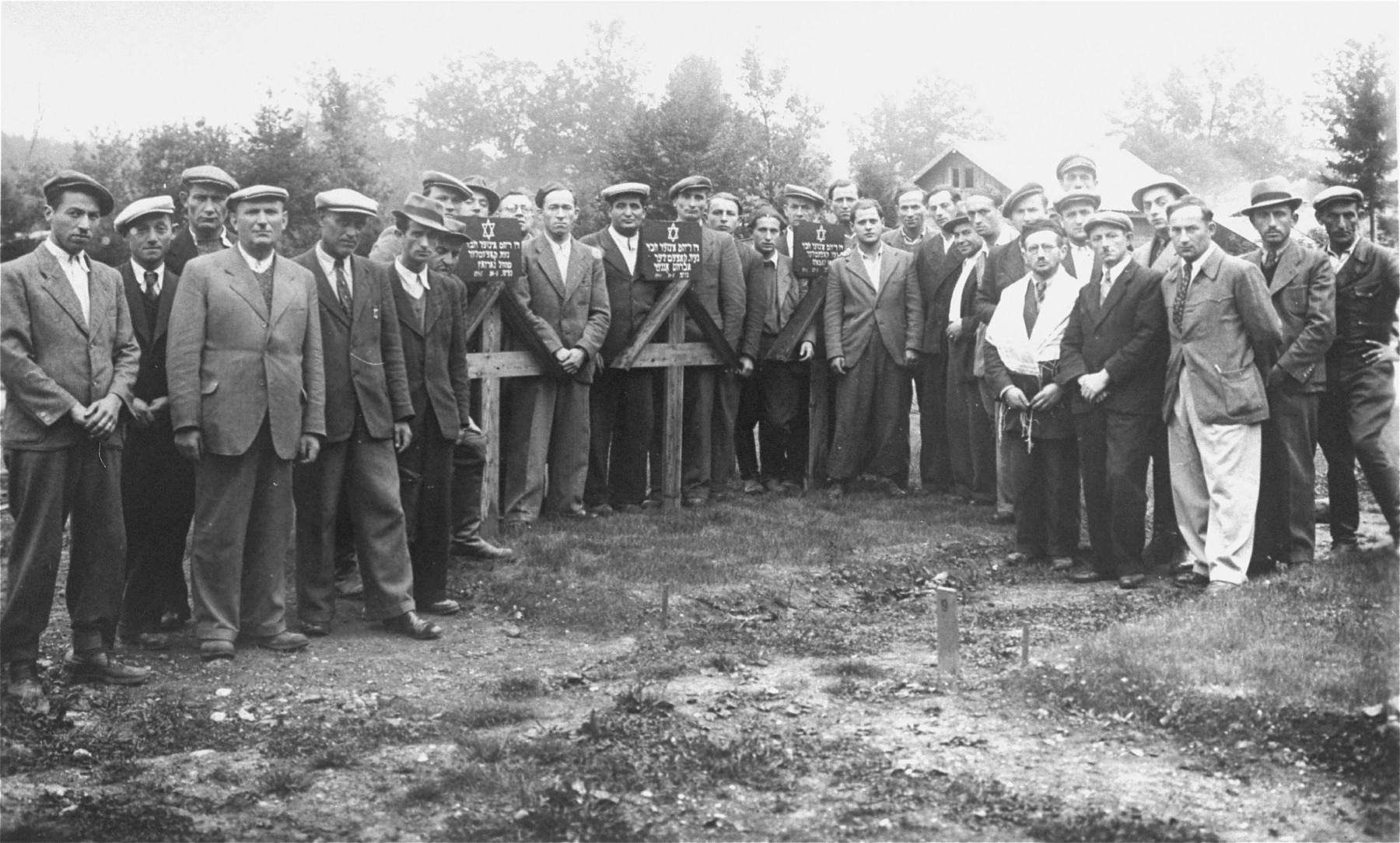 Jewish DPs gather for a memorial service in the Traunstein displaced persons camp.  Those pictured include Yankel Yakubovitz (the tall man in the center) and his brother, Aaron Yakubovitz.