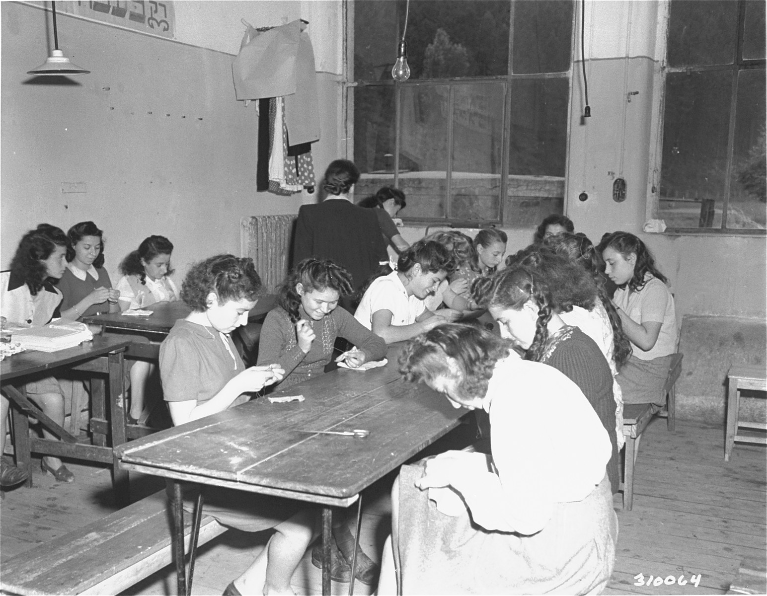 Young women learn to sew in a  vocational school at the Jewish displaced persons camp in Wetzlar.