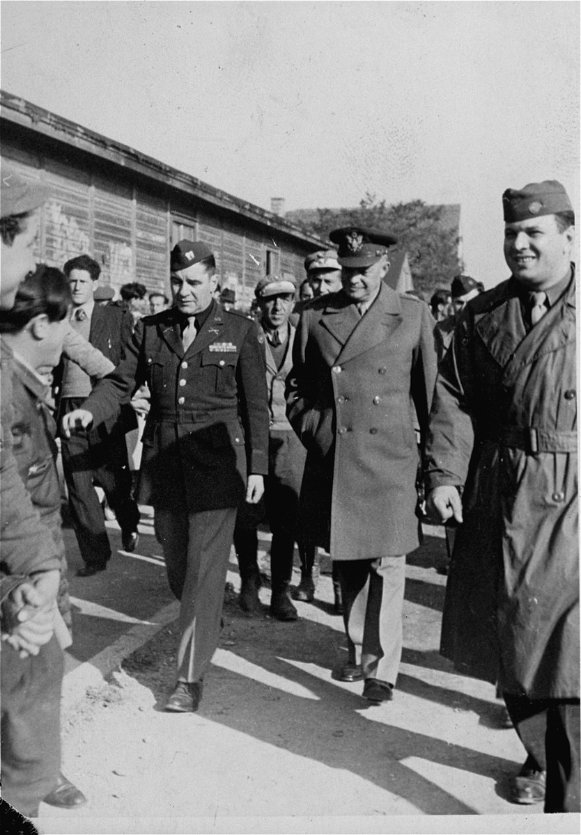 Camp director Saul Sorrin gives General Dwight Eisenhower a tour of the Neu Freimann displaced persons camp.  Eisenhower's visits to Neu Freimann and other displaced persons' camps in the fall of 1945 was prompted by a strongly worded cable he received  from President Truman directing him to institute reforms to improve living conditions of displaced Jews in the American zone of occupation.