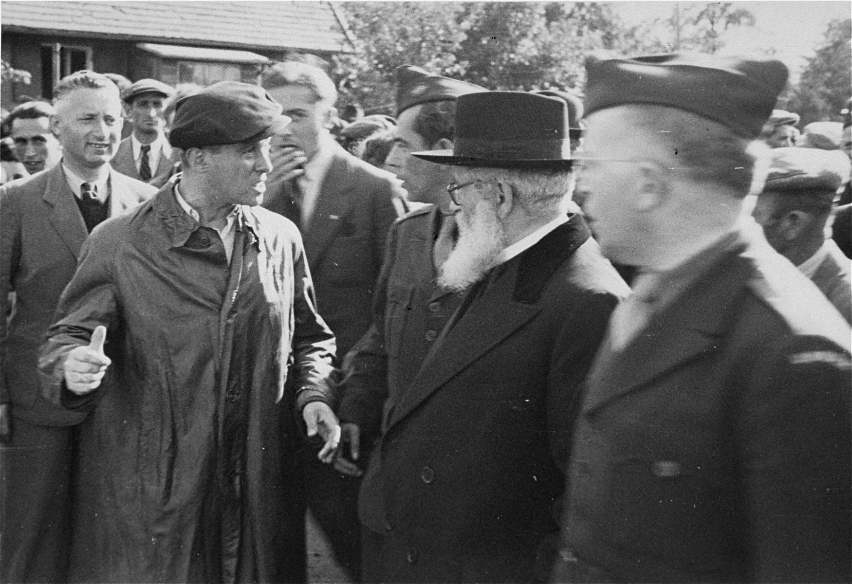 Chief Rabbi of Palestine, Isaac Herzog, pays an official visit to the Neu Freimann DP camp.  Solomon Wohlgelernter accompanies the Rabbi.