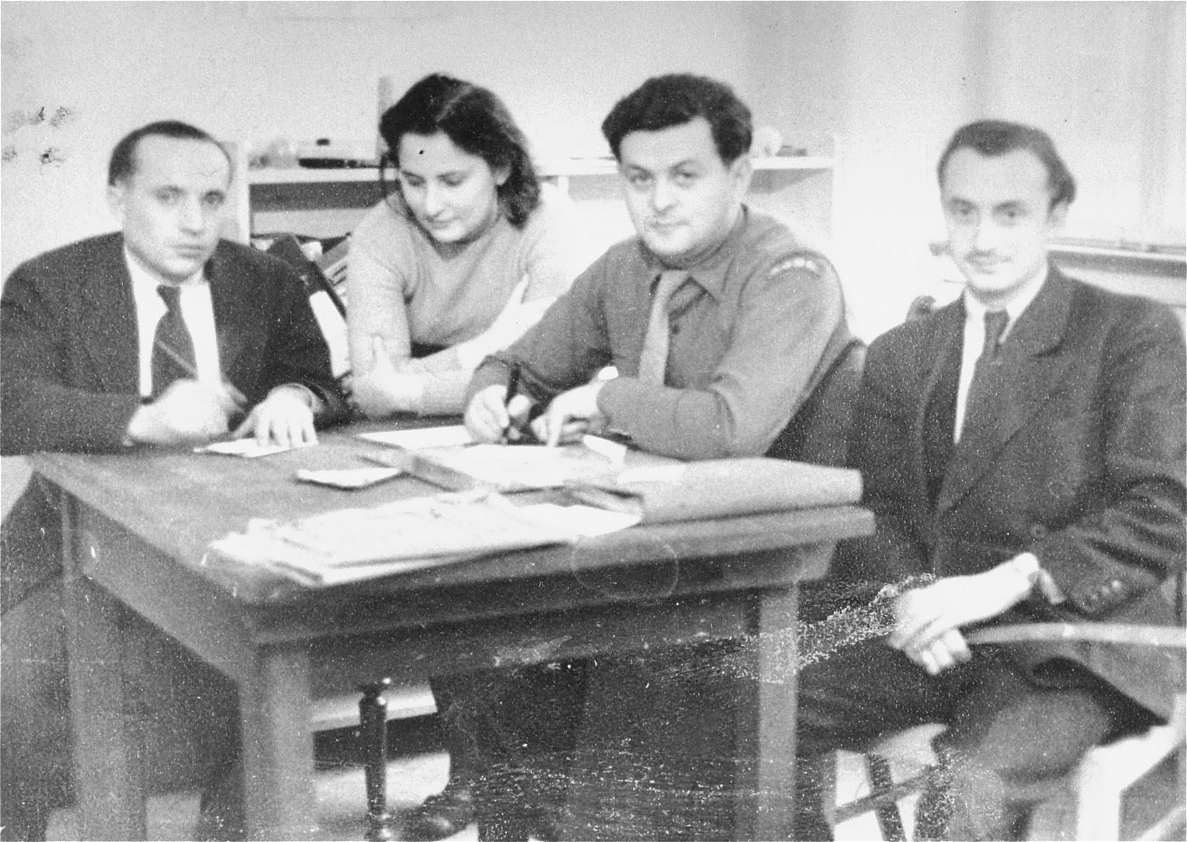UNRRA workers meet at Student's Hostel in Stuttgart.    Henry Brauner, UNRRA supply officer, is on the far right.