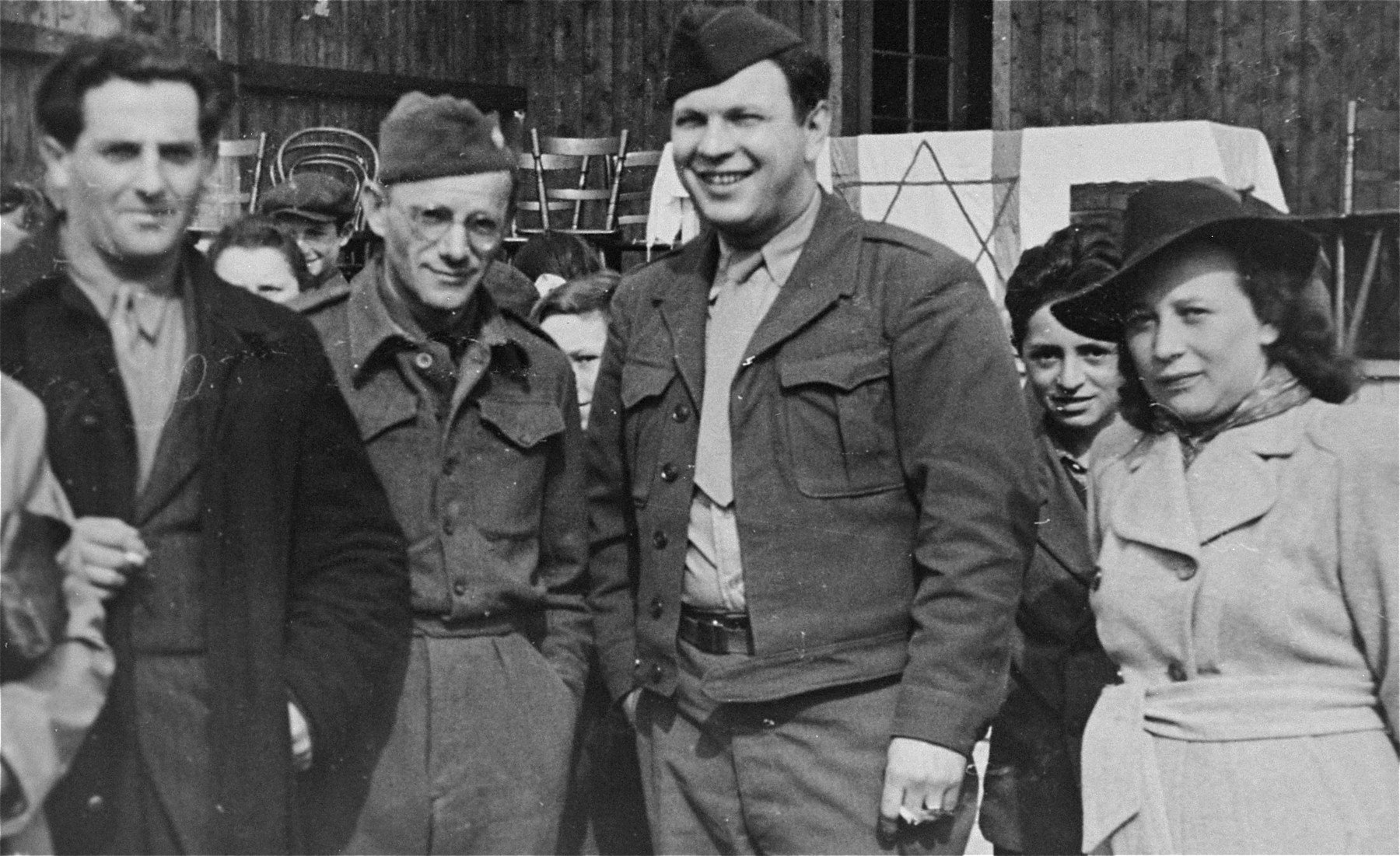 Neu Freimann director Saul Sorrin (third from the left) poses with other DP camp leaders in front of an outdoor stage used for public meetings at the Neu Freimann displaced persons camp.