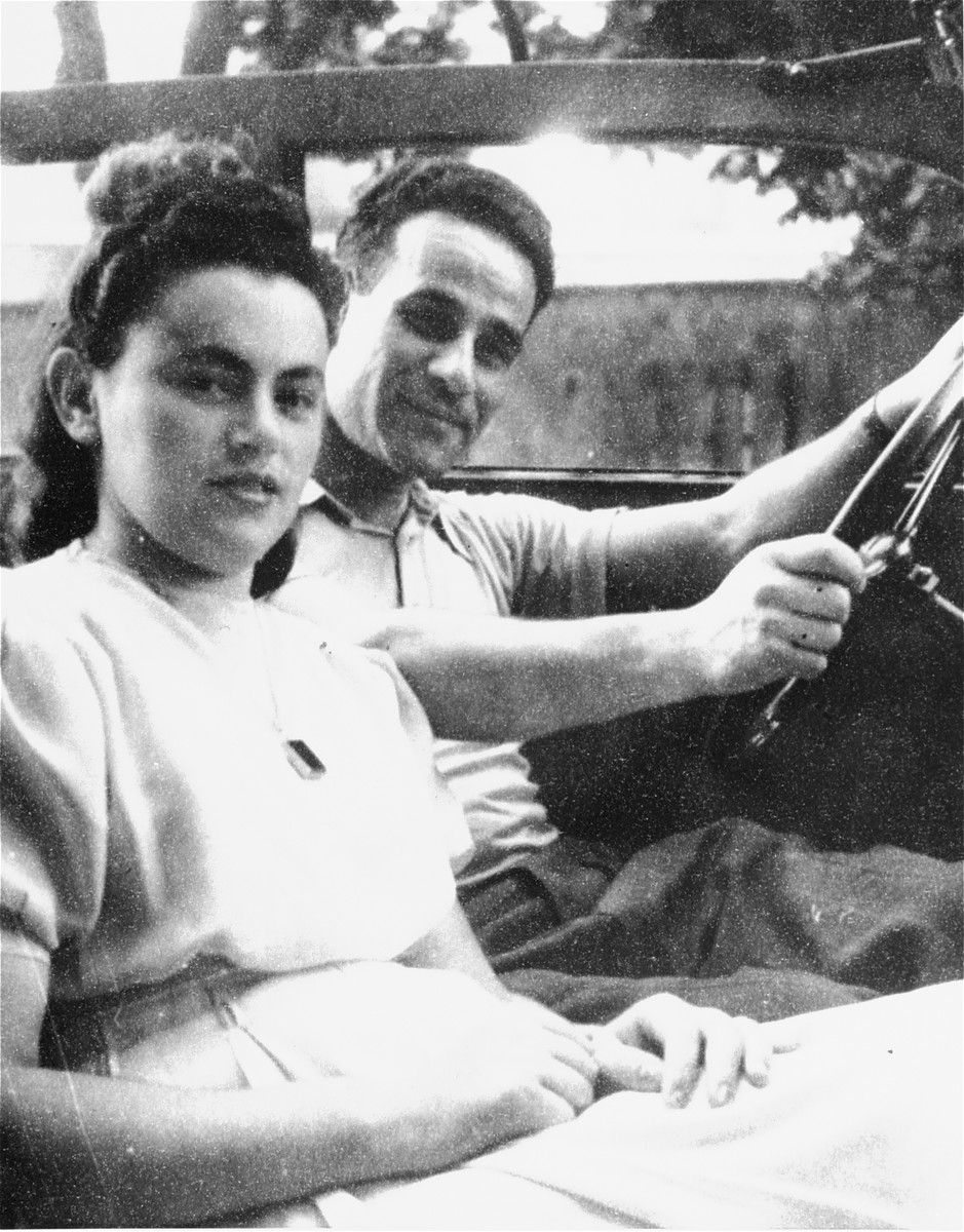 Max and Mardka Macher sit in a jeep outside the Stuttgart displaced persons camp.