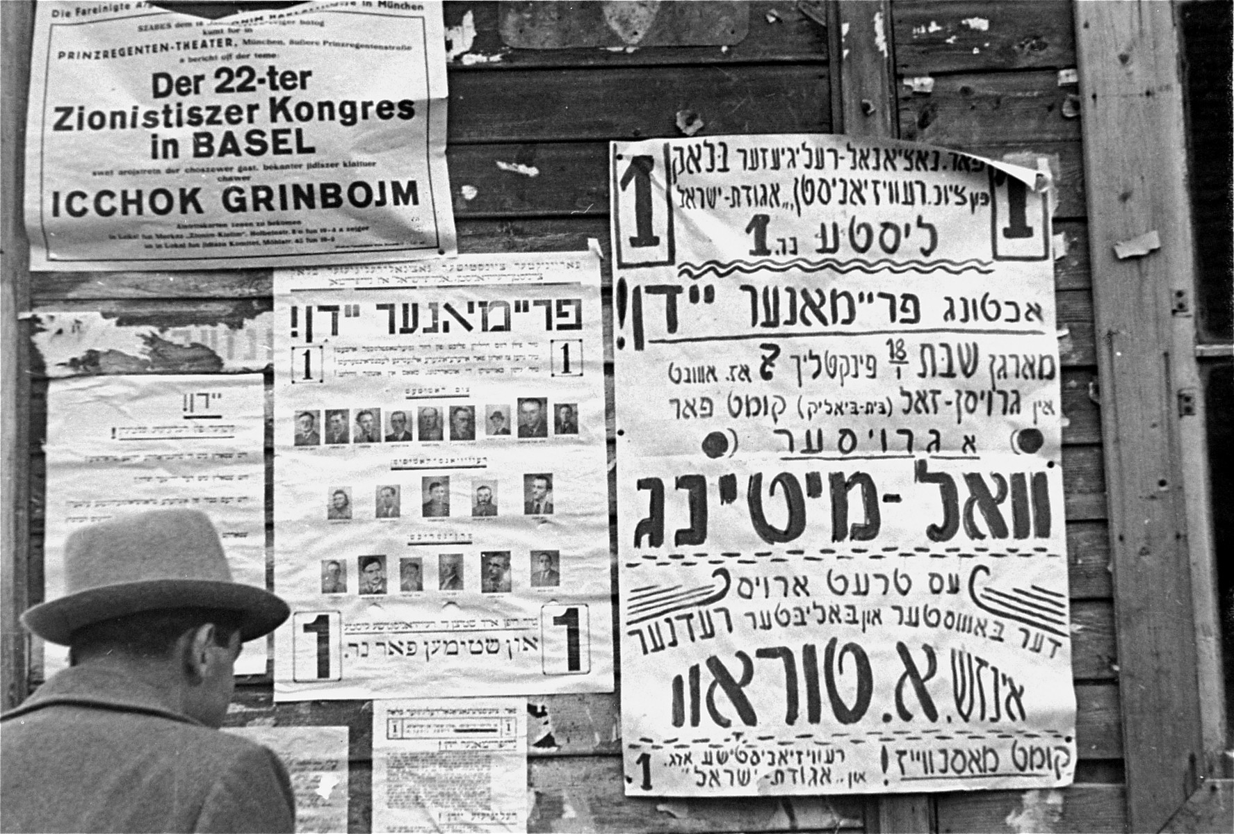 Election posters affixed to the wall of a barracks at the Neu Freimann displaced persons camp.