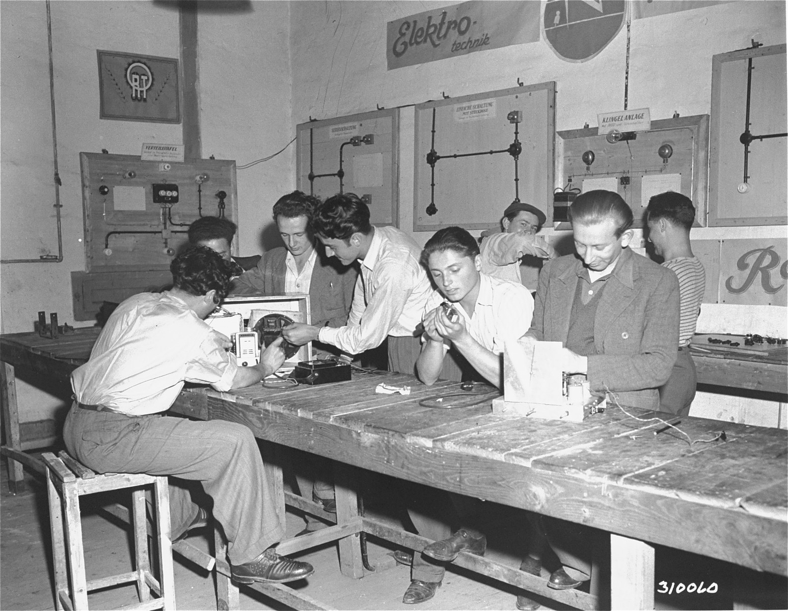 Jewish DP boys at the displaced persons camp in Wetzlar learn to repair radios at the camp's trade school.