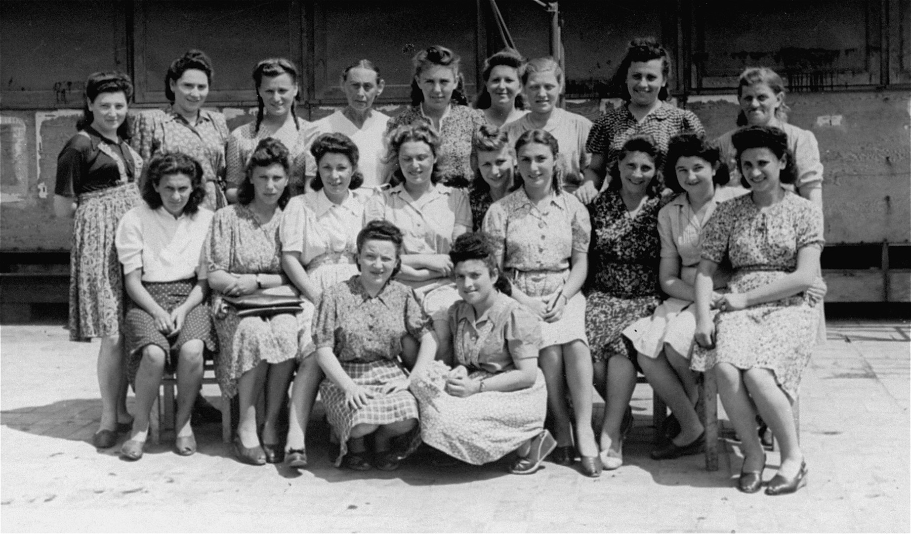 Young Jewish women pose outside their living quarters at the Neu Freimann (?) displaced persons camp.