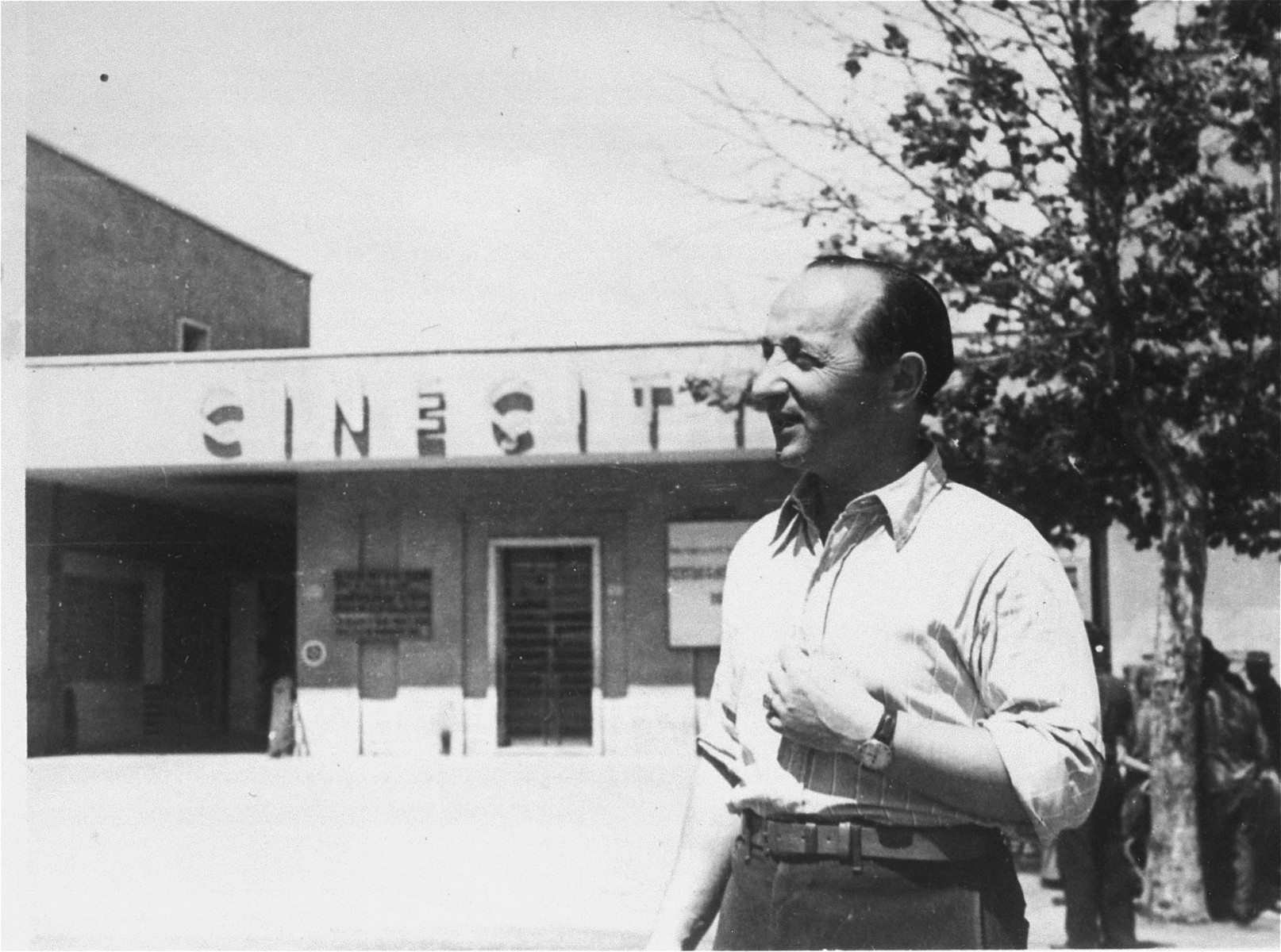 A Jewish DP poses at the entrance to the Cinecitta displaced persons camp in Rome.  Pictured is Edward Arzt.