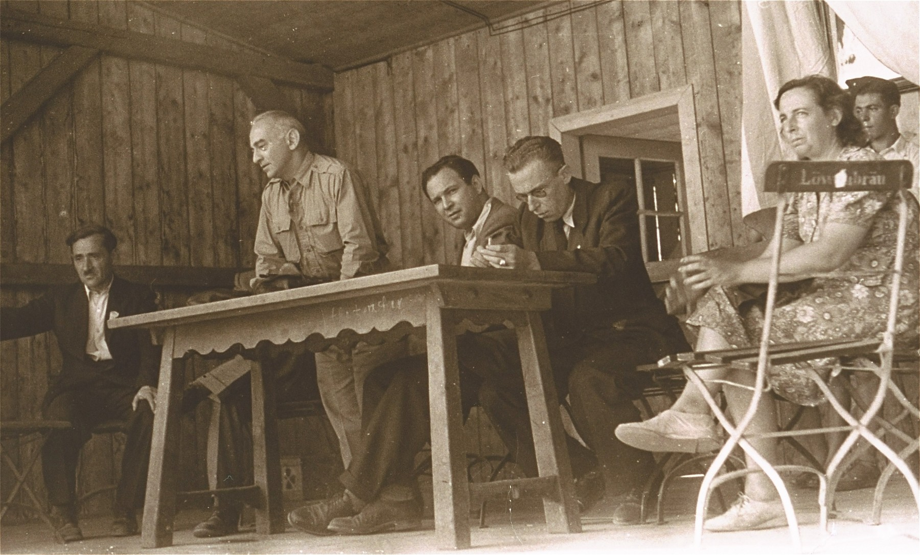 Saul Sorrin (third from left) shares the dais with the editor of the camp newspaper during a meeting at the Neu Freimann displaced persons camp.