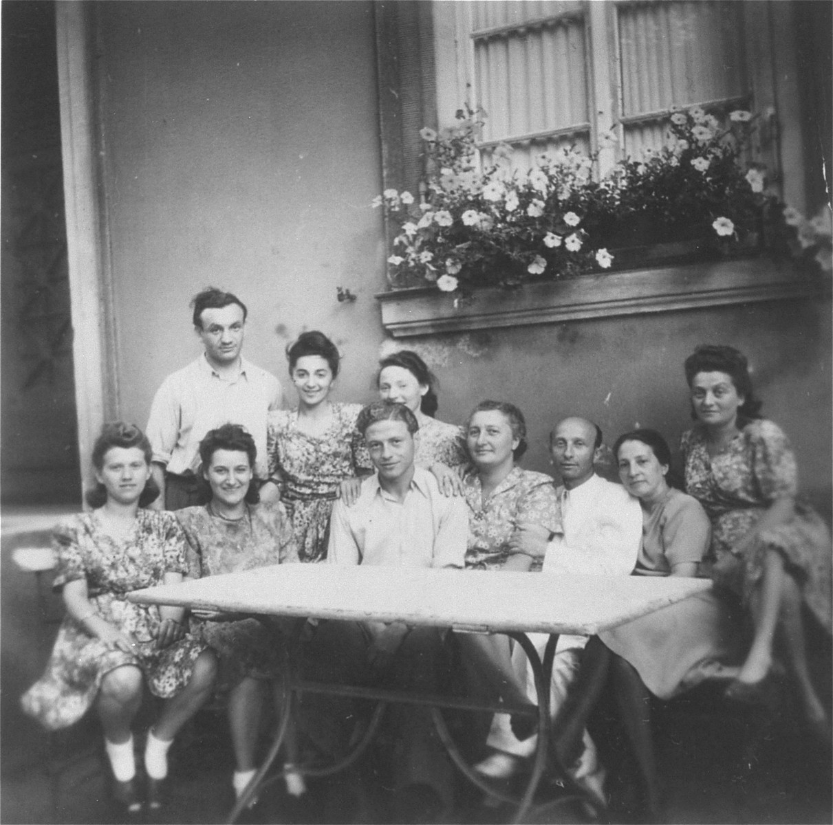 A group of Jewish displaced persons at the  Weiss cafe in the Weiden DP camp.    From the left, standing: Idek and Estera Pffefer; Sitting from left to right are Wadna, Helen Luksenburg (Chilewicz) and Willi (Welek) Luksenburg.  Next to them are Mr. and Mrs. Mates Billauer, head of the Jewish Community Center.  To the extreme right is Irke Haze.