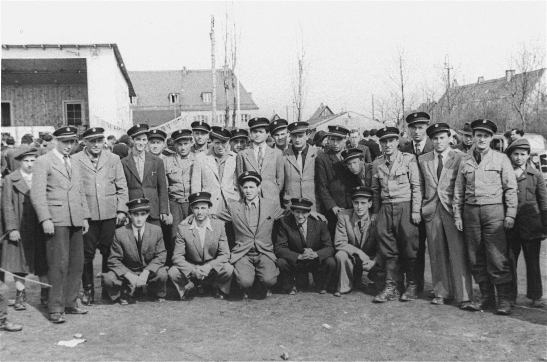 Group portrait of Jewish police at the Neu Freimann displaced persons camp.