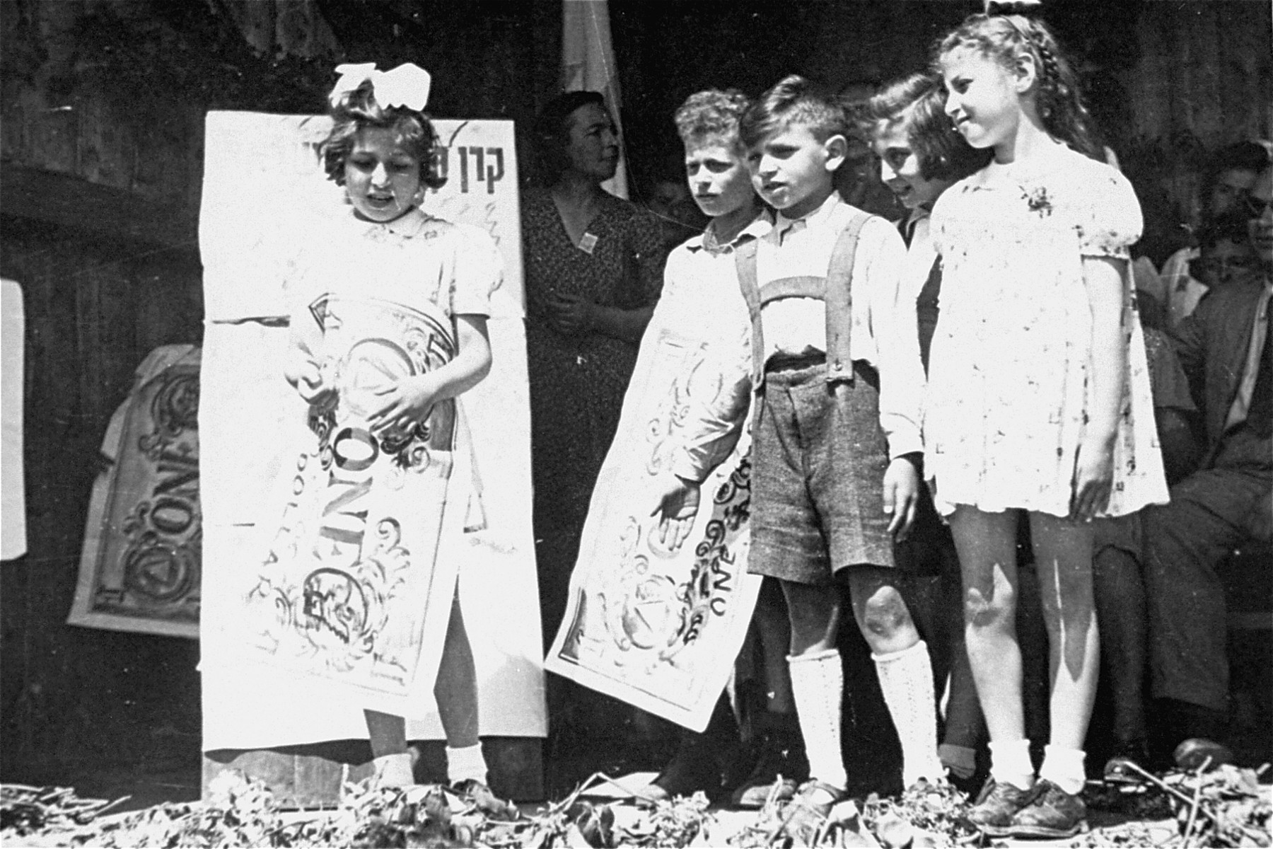 DP children help raise money for the Jewish National Fund in a displaced persons camp in Germany.
