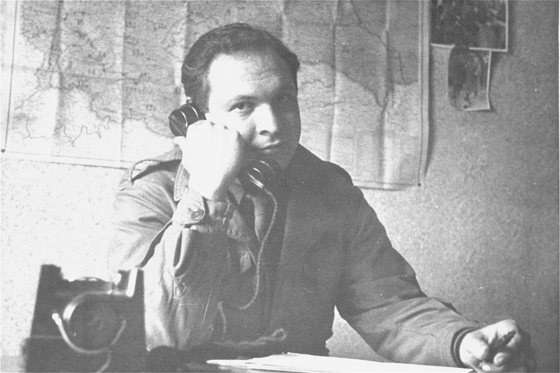 Saul Sorrin uses the telephone in his office at the Neu Freimann displaced persons camp.