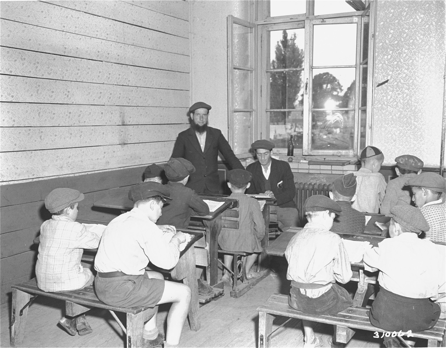 Boys at the Jewish displaced persons camp in Wetzlar go to the synagogue to study Torah.