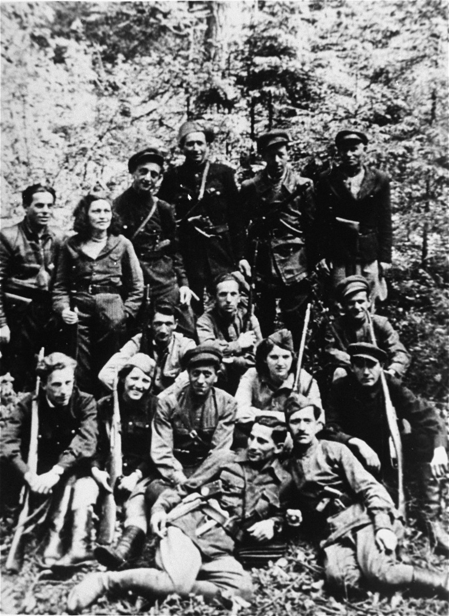Group portrait of a Jewish partisan unit operating in the Lithuanian forests.  Many of its members had been involved in resistance activities in the Kovno ghetto.  Pictured in the bottom row (from left to right) are Szymon Block and Mosze Szejman; second row: Michael Lefkowitz; Rivka Boruchowicz Tepper; David Tepper; Rivka Block; and Shlomo Brojer; third row: Yudel Edelman; Runia Schtrom; and Aaron Tabacznik; fourth row: Yankel Ratner; Ester Schtrom; Eliezer Zilberis; Liebe Zajac; Berl Sztern, and Itzhak Yuchnikov.