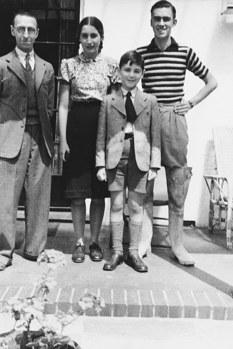 Elisabeth and Lux Adorno pose with Mr. Hulford, their first foster-parent after arriving in England on a Kindertransport.