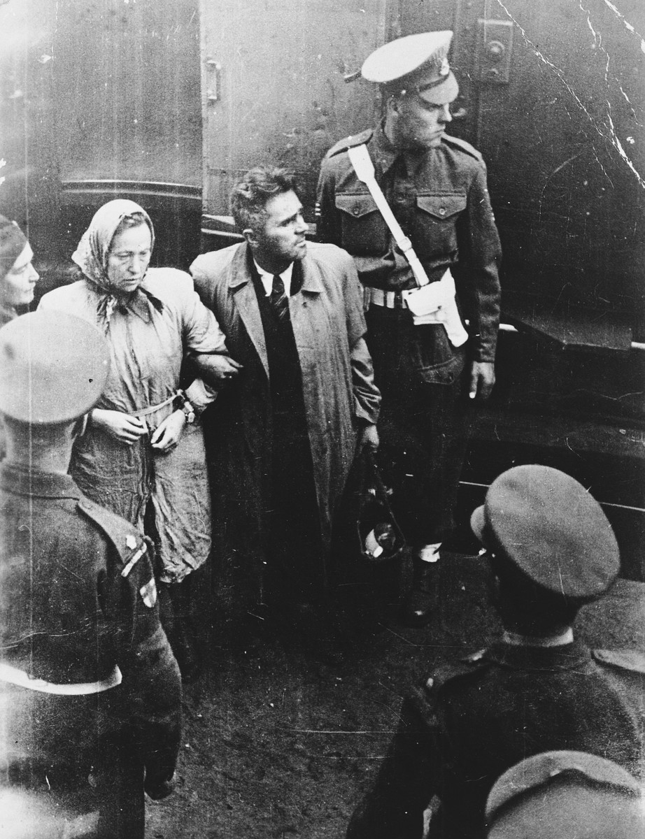 British soldiers attend a stricken female passenger and her husband at the Kuecknitz railroad station after their forcible return to Europe.  Pictured are Batia Michaele (Fleisher) Gutstein and her husband Michael Gutstein.