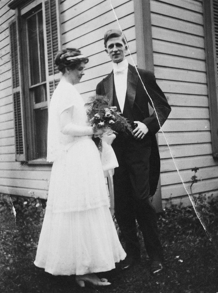 James and Ruth (Stafford) McDonald pose outside the Stafford family home in Albany, Indiana, on their wedding day.