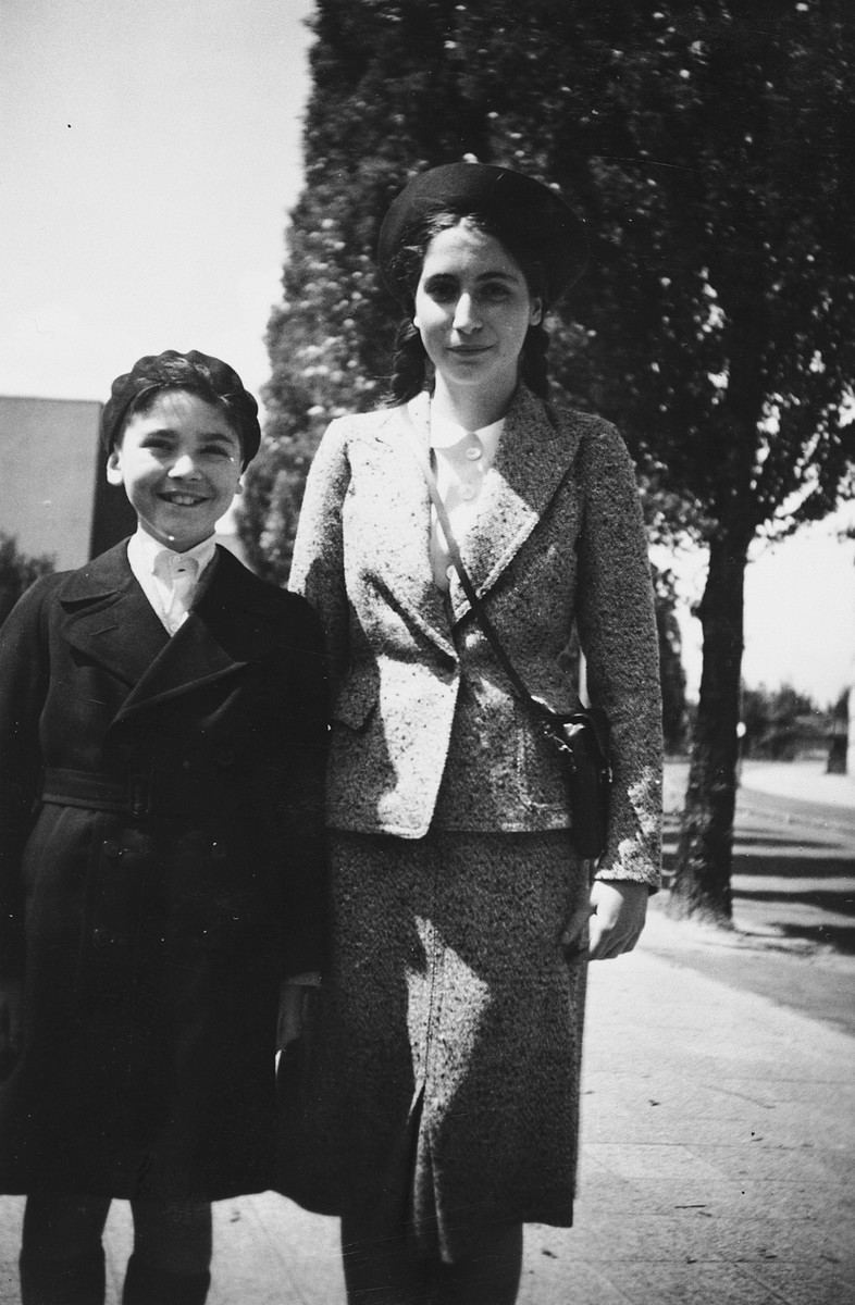 Elisabeth and Lux Adorno pose for a farewell portrait on a street in Frankfurt shortly before leaving for England on a Kindertransport.
