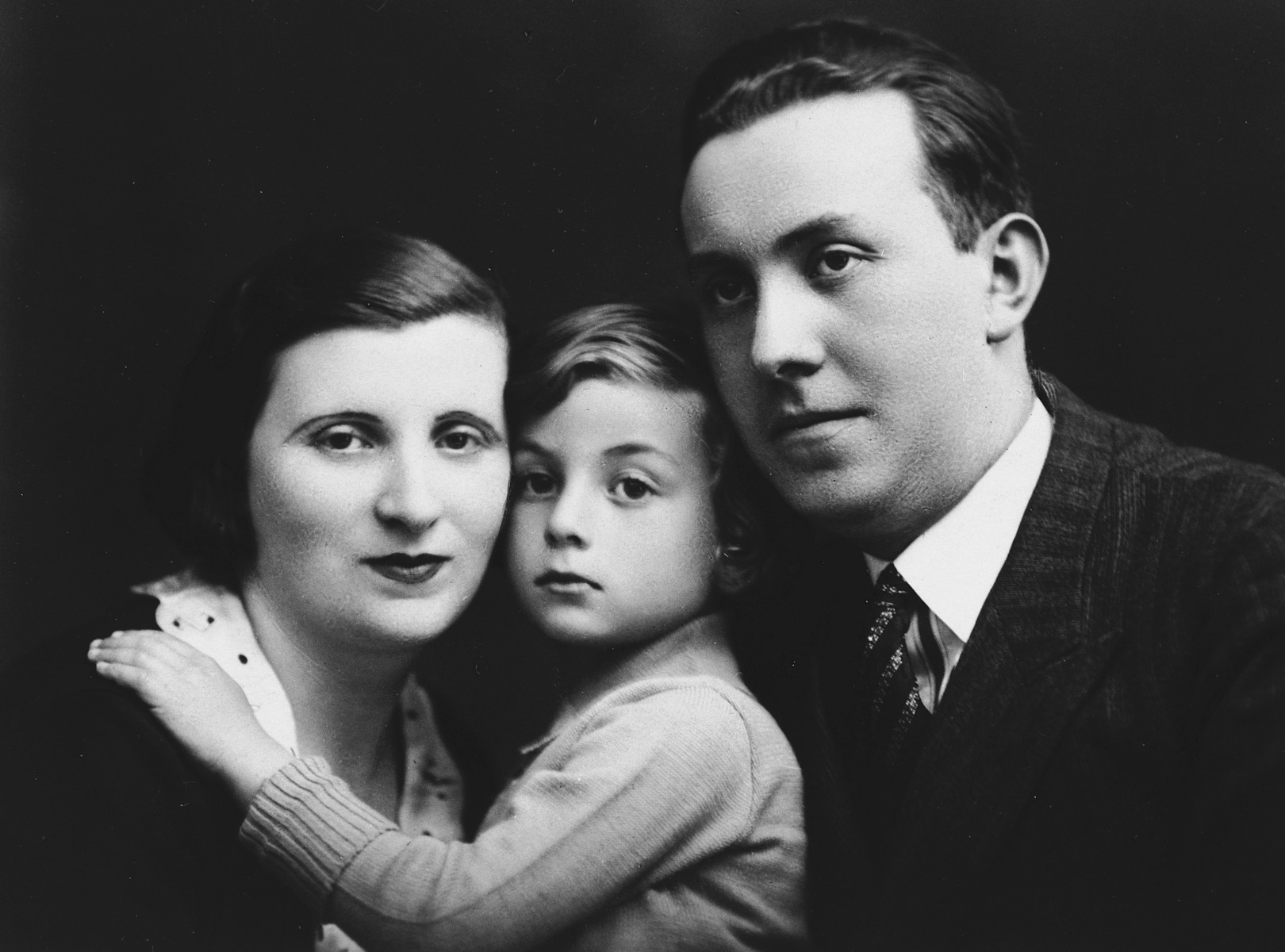 Studio portrait of the family of Sara Prawer Laskier, the donor's aunt.  Pictured are Sara Prawer Laskier, her son Sewek Osjasz and husband, Israel Srulek Laskier.  All three perished in Auschwitz.  Sewek died after throwing himself on the electrified fence.