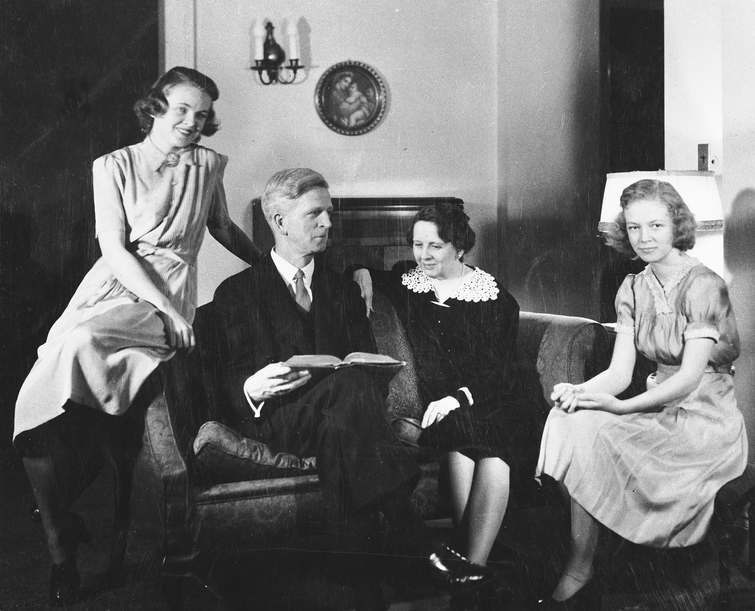 Studio portrait of the family of James G. McDonald in their home in Brooklyn.  Pictured from left to right are: Janet, James, Ruth, and Barbara McDonald.