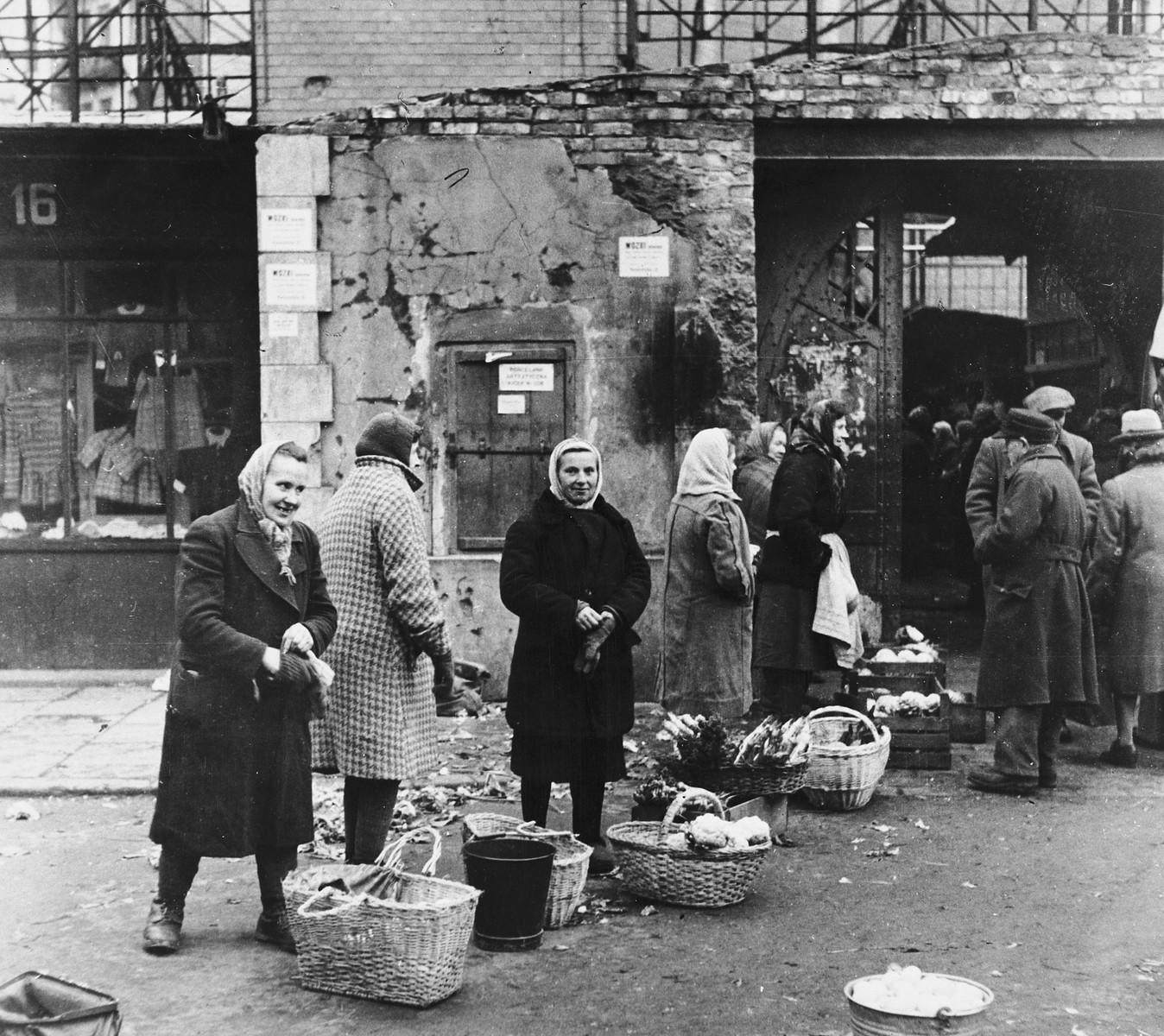 Polish women wait in line for bread in postwar Warsaw.