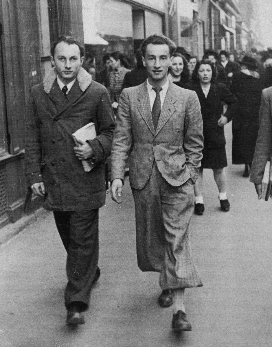 Two leaders of the Zionist underground, Mouvement de la Jeuness Sioniste, walk down a street in Grenoble.  On the left is Otto Giniewski, leader of the G'doud (unit) in Grenoble; on his right is Leon Roitman.