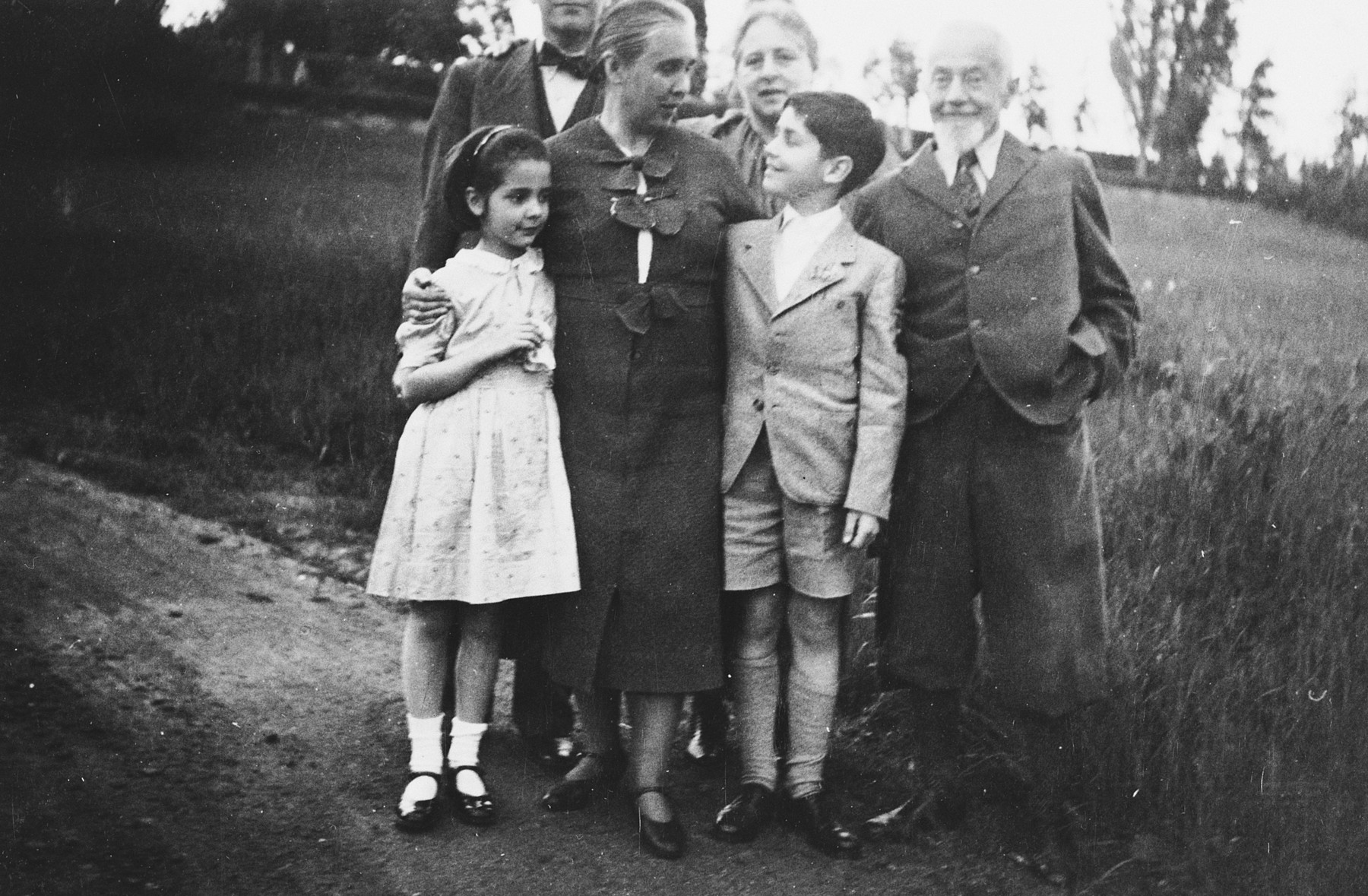 Elisabeth and Lux Adorno pay a farewell visit to their grandparents before leaving for England on a Kindertransport.