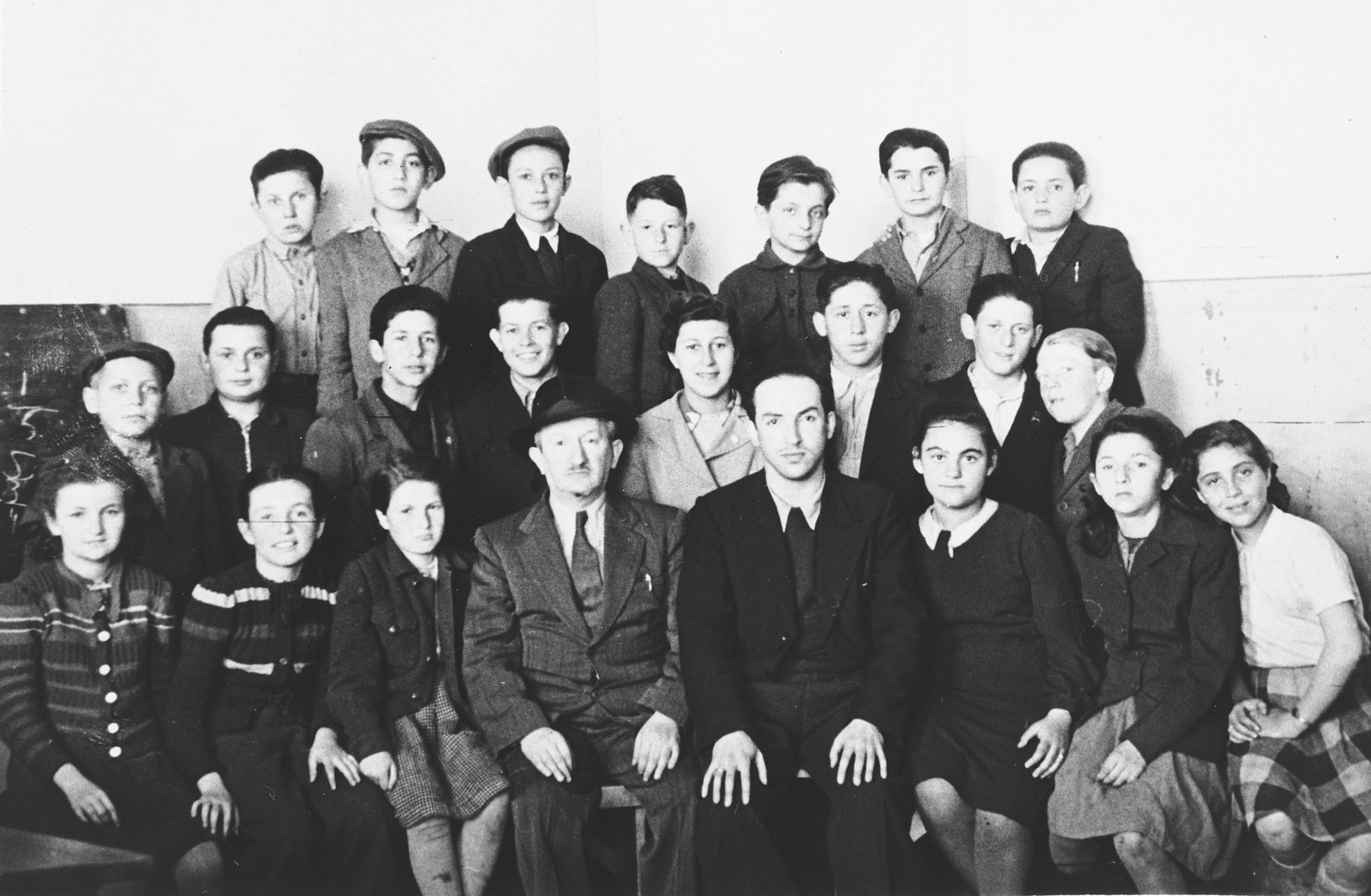 Group portrait of Jewish students and teachers in the Hasenecke DP camp school.  Pictured in the front row on the far right in the white shirt is Mania Wurm.