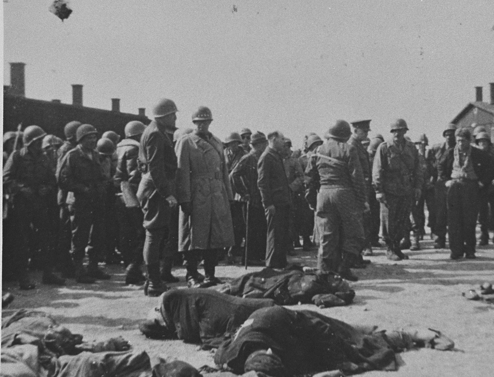 While on an inspection tour of the newly liberated Ohrdruf concentration camp, Generals Dwight Eisenhower, George Patton and Omar Bradley view the bodies of prisoners shot by SS during the evacuation of the camp.