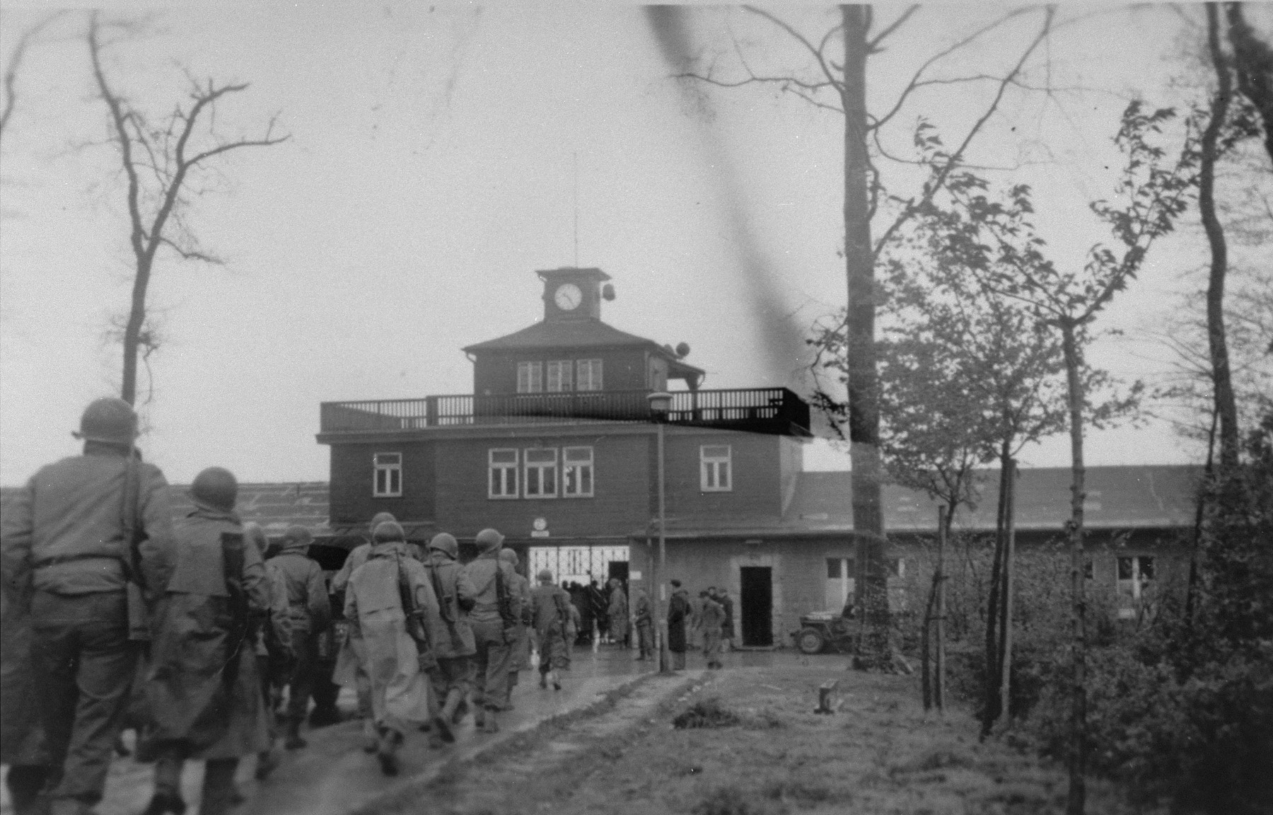American soldiers march into Buchenwald upon liberation of the camp.
